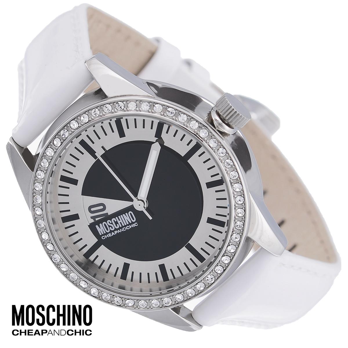 Часы женские наручные Moschino, цвет: белый, серебристый. MW0336MW0336Наручные часы от известного итальянского бренда Moschino - это не только стильный и функциональный аксессуар, но и современные технологи, сочетающиеся с экстравагантным дизайном и индивидуальностью. Часы Moschino лаконичного дизайна оснащены кварцевым механизмом. Корпус выполнен из высококачественной нержавеющей стали и по контуру циферблата оформлен стразами. Циферблат с арабскими цифрами и отметками защищен минеральным стеклом. Часы имеют две стрелки - часовую и минутную. Ремешок часов выполнен из натуральной лаковой кожи и оснащен классической застежкой. Часы упакованы в фирменную металлическую коробку с логотипом бренда. Часы Moschino благодаря своему уникальному дизайну отличаются от часов других марок своеобразными циферблатами, функциональностью, а также набором уникальных технических свойств. Каждой модели присуща легкая экстравагантность, самобытность и, безусловно, великолепный вкус. Характеристики: Диаметр...