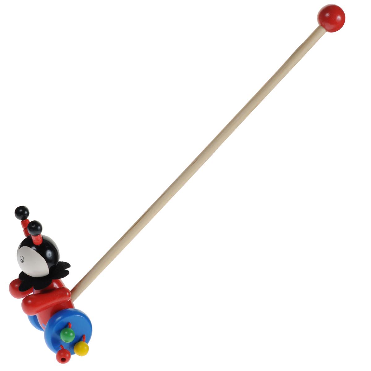 Mapacha Деревянная игрушка-каталка Божья коровка76411Яркая игрушка-каталка Mapacha Божья коровка непременно понравится вашему малышу и подойдет для игры как дома, так и на свежем воздухе. Яркая игрушка выполнена из дерева в виде божьей коровки на колесиках. Ее усики крепятся к головке эластичной резинкой. К колесикам игрушки с помощью текстильных шнурочков крепятся разноцветные деревянные шарики, которые гремят во время движения. Ручку-держатель можно открутить и играть только с игрушкой. В целях безопасности ручка дополнена круглым набалдашником. Игрушка-каталка Mapacha Божья коровка способствует физическому развитию малыша - помогает сделать первые шаги и освоить навыки ходьбы. Развивает координацию движений и способность ориентироваться в пространстве.