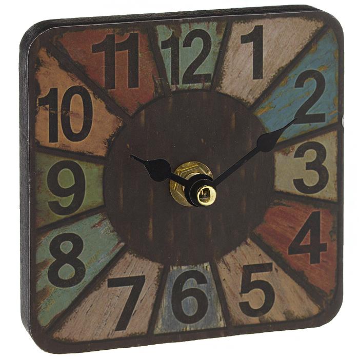 Часы настольные Радуга. 3584535845Настольные часы Радуга станут оригинальным элементом декора в доме, офисе или на даче. Часы выполнены из МДФ в квадратном корпусе и украшены разноцветными сегментами. Часы имеют две стрелки - часовую и минутную. Циферблат оформлен крупными арабскими цифрами. С задней стороны имеется металлическая ножка. Настольные часы Радуга станут не только оригинальным украшением стола, но и прекрасным подарком, который обязательно понравится получателю. Размер корпуса: 10 см х 10 см х 1,2 см. Часы работают от одной батарейки типа АА (в комплект не входит).