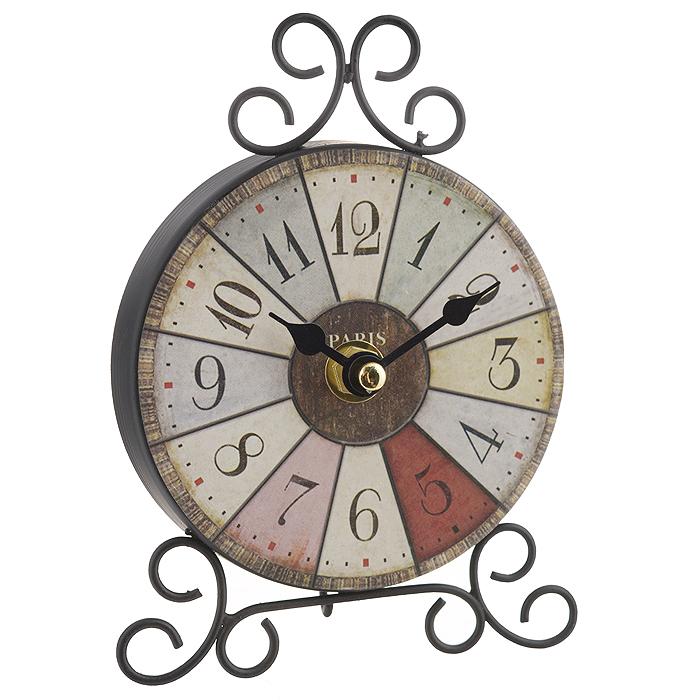 Часы настольные Калейдоскоп. 3583735837Настольные часы Калейдоскоп станут оригинальным элементом декора в доме, офисе или на даче. Часы выполнены из черного металла в круглом корпусе и украшены разноцветными сегментами. Часы имеют две стрелки - часовую и минутную. Циферблат оформлен крупными арабскими цифрами. Настольные часы Калейдоскоп станут не только оригинальным украшением стола, но и прекрасным подарком, который обязательно понравится получателю. Диаметр циферблата: 10 см. Общий размер часов (ДхШхВ): 11 см х 4 см х 15 см. Часы работают от одной батарейки типа АА (в комплект не входит).