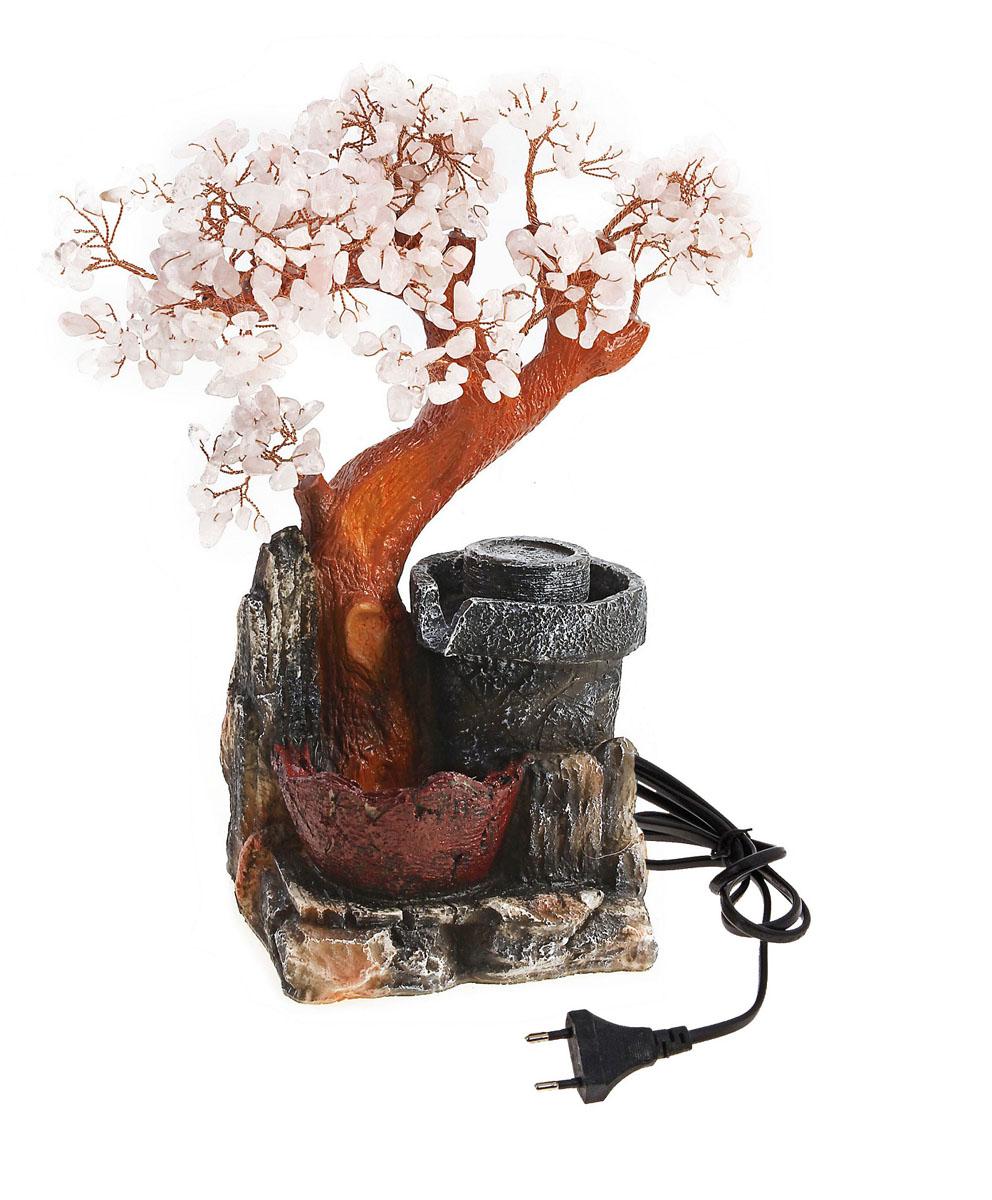 Фонтан Sima-land Гармония455866Фонтан Sima-land Гармония, изготовленный из полистоуна, украсит интерьер любого помещения. Изделие выполнено в виде дерева бонсай с листьями из декоративных камней. Дерево расположено рядом с источником, из которого вытекает вода. Фонтан подсвечивается разноцветными светодиодами. По древнекитайскому учению Фен-Шуй фонтаны являются символами жизненной энергии, изобилия. В комнате их нужно размещать в зоне карьеры и удачи. Тогда фонтаны привлекут в ваш дом богатство, материальный достаток. Даже если вы не являетесь поклонником Фен-Шуй, фонтаны наполнят помещение тихим, мелодичным журчанием воды, что благотворно скажется на вашей нервной системе и позволит снять стресс. Каждому хозяину периодически приходит мысль обновить свою квартиру, сделать ремонт, перестановку или кардинально поменять внешний вид каждой комнаты. Фонтан - привлекательная деталь в обстановке, которая поможет воплотить вашу интерьерную идею, создать неповторимую атмосферу в...