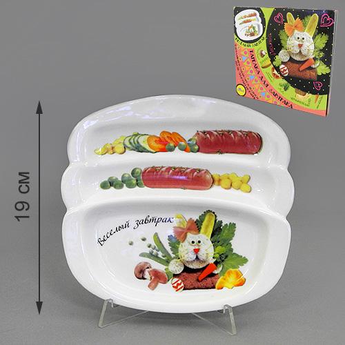 Блюдо для сосисок LarangE Веселый завтрак с зайчиком, 20,5 см х 19 см553-203Блюдо для сосисок LarangE Веселый завтрак с зайчиком изготовлено из высококачественной керамики. Изделие украшено изображением зайца и еды. Тарелка имеет три отделения: 2 маленьких отделения для сосисок и одно большое отделение для яичницы или другого блюда. Можно использовать в СВЧ печах, духовом шкафу и холодильнике. Не применять абразивные чистящие вещества.
