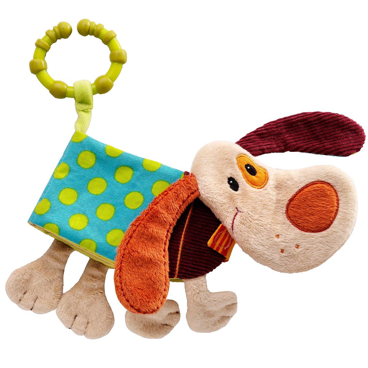 Развивающая игрушка-книжка Lilliputiens Собачка Джеф86262Мягкая развивающая игрушка-книжка Lilliputiens Собачка Джеф непременно понравится вашему малышу. Она выполнена из текстильного материала разных цветов и фактур в виде собачки. Туловище Джефа представляет собой книжку с четырьмя мягкими страничками, на которых изображены различные животные. Странички книжечки закрепляются с помощью хлястика на липучке. В последней страничке спрятана сфера, гремящая при тряске. С помощью незамкнутого кольца игрушку можно прикрепить к автокреслу, коляске, кроватке или игровой дуге малыша. Книжка-игрушка поможет ребенку развить цветовое и звуковое восприятие, тактильные ощущения, мелкую моторику рук, когнитивное восприятие, а также познакомит с окружающим миром.