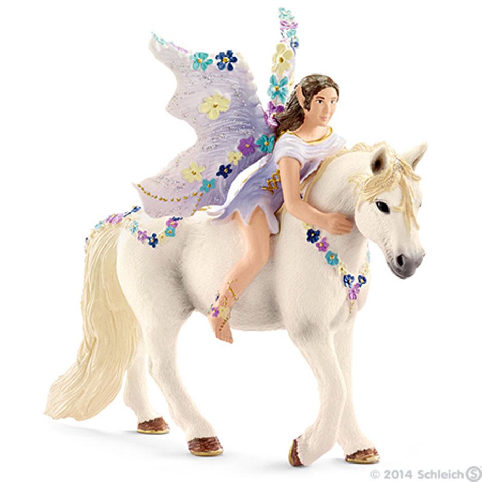 Фигурка Schleich Эльф Олеана на лошади, 10,2 см70410Фигурка Schleich Эльф Олеана на лошади станет прекрасным подарком для вашего ребенка. Она выполнена из каучукового пластика. Фигурка выполнена в виде красивого лесного эльфа с крылышками и темными волосами, который сидит верхом на лошади. Детали фигурки четкие и максимально детализированы, что привлекает внимание деток, которые с огромным удовольствием будут играть с ней в ролевые игры. Фигурка разъемная и ваш ребенок может играть отдельно как с эльфом, так и с единорогом. Такая фигурка непременно понравится вашему ребенку и станет замечательным украшением любой коллекции. Цветочный эльф Олеана очень любит. Она даже крылышки свои украсила цветочными бутонами. Олеана и лошадка - неразлучные друзья. Иногда она даже засыпает вместе с ней. В своих дальних путешествиях эльф пытается найти самые редкие и удивительные цветы, а потом восхитительными букетами и венками украшает эльфийские праздники и торжества. И, конечно, любимую лошадку.