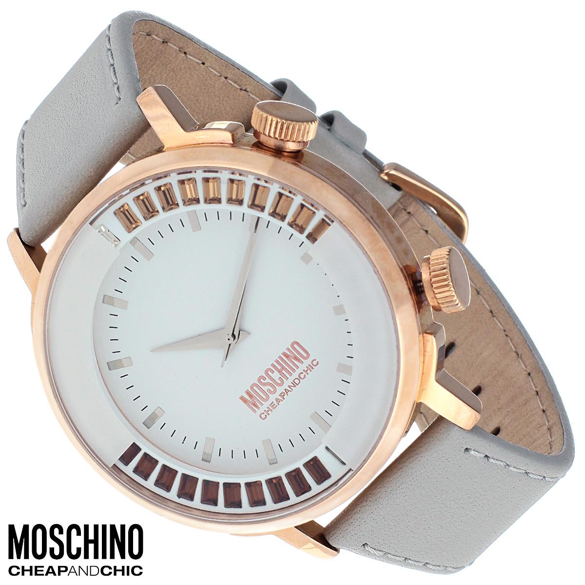 Часы женские наручные Moschino, цвет: золотой, светло-серый. MW0429MW0429Наручные часы от известного итальянского бренда Moschino - это не только стильный и функциональный аксессуар, но и современные технологи, сочетающиеся с экстравагантным дизайном и индивидуальностью. Часы Moschino оснащены кварцевым механизмом. Корпус выполнен из высококачественной нержавеющей стали с PVD-покрытием. Циферблат с отметками защищен минеральным стеклом и декорирован цветными стразами. Часы имеют три стрелки - часовую, минутную и секундную. Ремешок часов выполнен из натуральной кожи и оснащен классической застежкой. Часы упакованы в фирменную металлическую коробку с логотипом бренда. Часы Moschino благодаря своему уникальному дизайну отличаются от часов других марок своеобразными циферблатами, функциональностью, а также набором уникальных технических свойств. Каждой модели присуща легкая экстравагантность, самобытность и, безусловно, великолепный вкус. Характеристики: Диаметр циферблата: 3,2 см. Размер корпуса:...