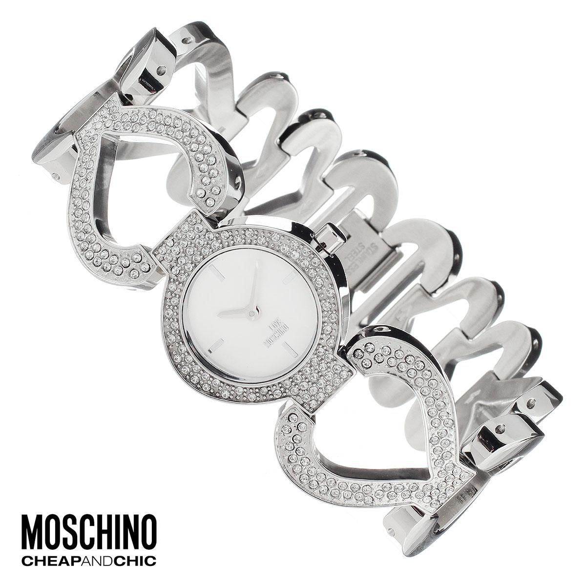 """Часы женские наручные Moschino, цвет: серебристый. MW0431MW0431Наручные часы от известного итальянского бренда Moschino - это не только стильный и функциональный аксессуар, но и современные технологи, сочетающиеся с экстравагантным дизайном и индивидуальностью. Часы Moschino оснащены кварцевым механизмом. Корпус выполнен из высококачественной нержавеющей стали и украшен стразами. Циферблат с отметками оформлен надписью """"Love Moschino"""" и защищен минеральным стеклом. Часы имеют две стрелки - часовую и минутную. Браслет часов выполнен из нержавеющей стали и состоит из звеньев в форме сердца. Браслет застегивается на ювелирную застежку. Часы упакованы в фирменную металлическую коробку с логотипом бренда. Часы Moschino благодаря своему уникальному дизайну отличаются от часов других марок своеобразными циферблатами, функциональностью, а также набором уникальных технических свойств. Каждой модели присуща легкая экстравагантность, самобытность и, безусловно, великолепный вкус. Характеристики: ..."""