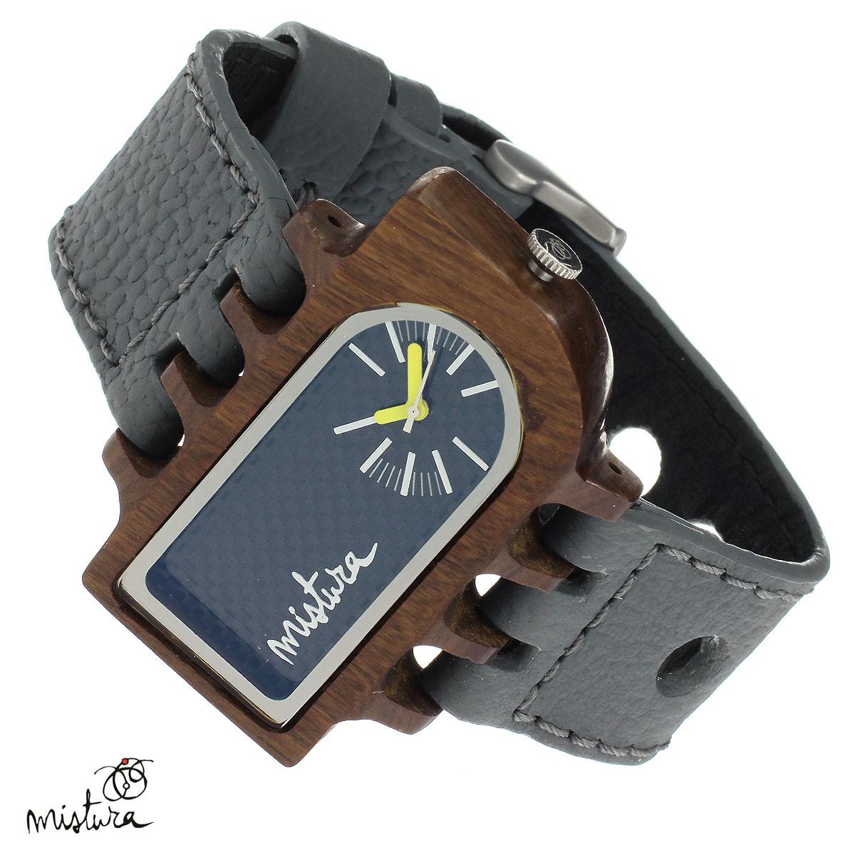Часы наручные Mistura Umbra, цвет: серый. TP12015GYPUCFWDTP12015GYPUCFWDНаручные часы Mistura благодаря своему эксклюзивному дизайну позволят вам выделиться из толпы и подчеркнуть свою индивидуальность. Для изготовления корпуса часов используется древесина тропических лесов Колумбии с применением индивидуальных методов ее обработки. Дизайн выполняется вручную. Часы оснащены японским кварцевым механизмом MIYOTA. Широкий ремешок из натуральной кожи с фактурной поверхностью оформлен декоративной отстрочкой, застегивается на застежку с деревянным язычком. Корпус часов изготовлен из дерева пуи. Циферблат оформлен отметками и защищен минеральным стеклом. Часы имеют функцию защиты от брызг, вы можете находиться в них под дождем в течение недолгого времени. Изделие упаковано в фирменную коробку с логотипом компании Mistura. Часы марки Mistura идеально подходят молодым и уверенным в себе людям, ценящим качество, практичность и индивидуальность в каждой детали. Каждая модель оснащена оригинальным дизайнерским корпусом, а...