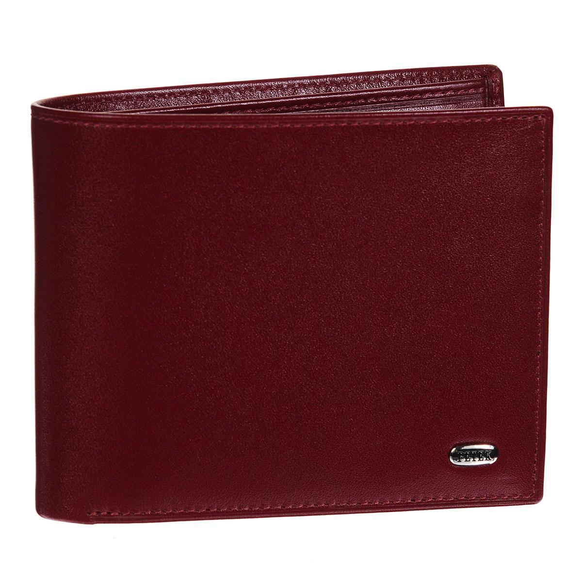 """Портмоне Petek, цвет: красный. 293.4000.10293.4000.10 RedСтильное портмоне Petek изготовлено из высококачественной натуральной кожи с гладкой поверхностью. Внутри - два отделения для купюр, карман для мелочи на кнопке, кармашек с сетчатым """"окошком"""", три наборных кармашка для кредитных карт и съемная визитница, рассчитанная на восемь визиток. Стильное и практичное портмоне Petek идеально подчеркнет ваш образ. Упаковано в фирменную картонную коробку."""