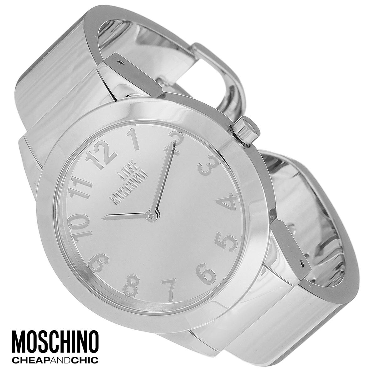 Часы женские наручные Moschino, цвет: серебристый. MW0438MW0438Наручные часы от известного итальянского бренда Moschino - это не только стильный и функциональный аксессуар, но и современные технологи, сочетающиеся с экстравагантным дизайном и индивидуальностью. Часы Moschino оснащены кварцевым механизмом. Корпус выполнен из высококачественной нержавеющей стали. Циферблат оформлен арабскими цифрами, надписью Love Moschino и защищен минеральным стеклом. Часы имеют две стрелки - часовую и минутную. Браслет часов выполнен из нержавеющей стали и имеет разъемную конструкцию. Часы упакованы в фирменную металлическую коробку с логотипом бренда. Часы Moschino благодаря своему уникальному дизайну отличаются от часов других марок своеобразными циферблатами, функциональностью, а также набором уникальных технических свойств. Каждой модели присуща легкая экстравагантность, самобытность и, безусловно, великолепный вкус. Характеристики: Диаметр циферблата: 3 см. Размер корпуса: 3,7 см х 4,4 см х...