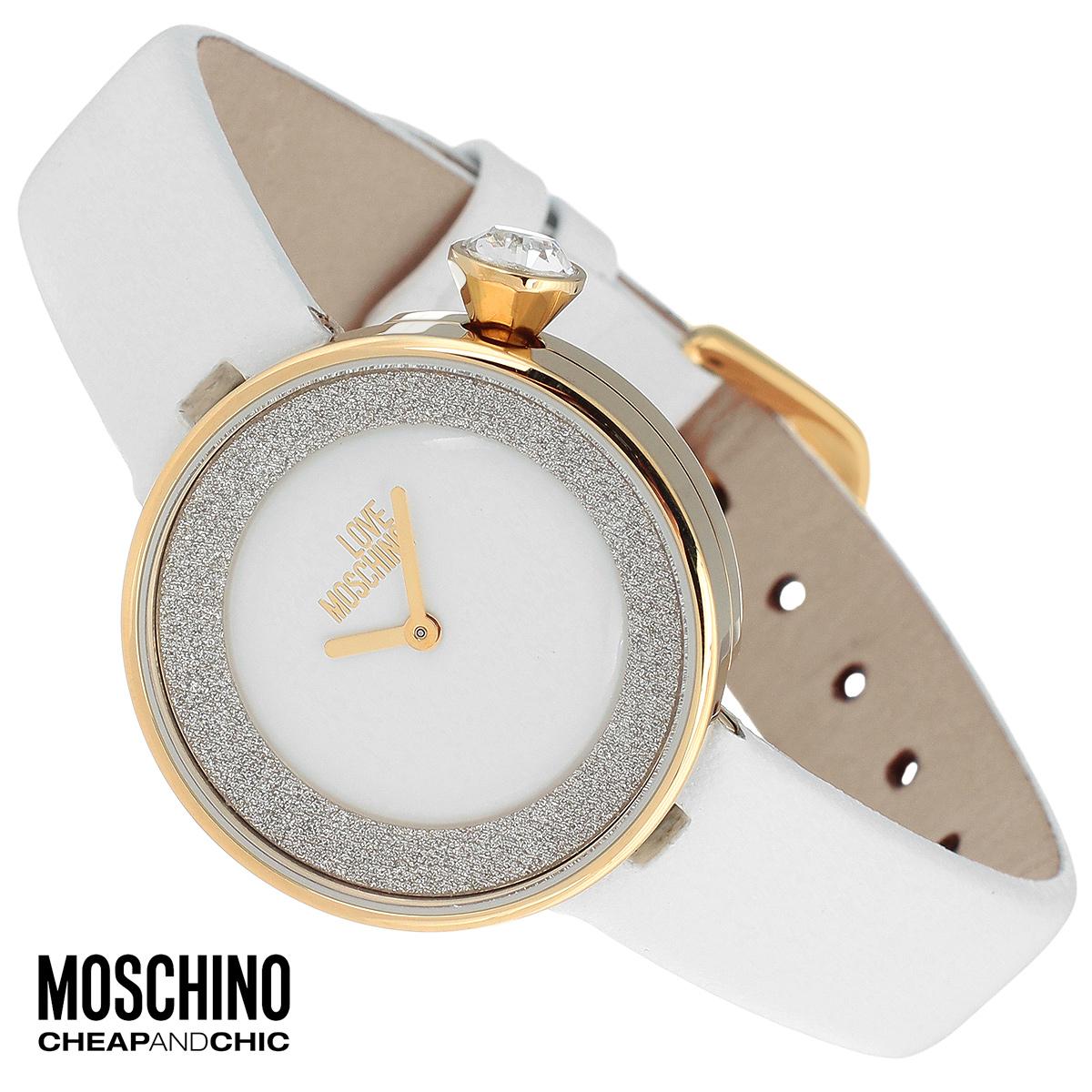 """Часы женские наручные Moschino, цвет: белый, золотой. MW0428MW0428Наручные часы от известного итальянского бренда Moschino - это не только стильный и функциональный аксессуар, но и современные технологи, сочетающиеся с экстравагантным дизайном и индивидуальностью. Часы Moschino оснащены кварцевым механизмом. Корпус выполнен из высококачественной нержавеющей стали с PVD-покрытием и по контуру циферблата декорирован блестками. Циферблат без отметок оформлен надписью """"Love Moschino и защищен минеральным стеклом. Часы имеют две стрелки - часовую и минутную. Ремешок часов выполнен из натуральной кожи и имеет классическую застежку. Часы упакованы в фирменную металлическую коробку с логотипом бренда. Часы Moschino благодаря своему уникальному дизайну отличаются от часов других марок своеобразными циферблатами, функциональностью, а также набором уникальных технических свойств. Каждой модели присуща легкая экстравагантность, самобытность и, безусловно, великолепный вкус. Характеристики: Диаметр..."""
