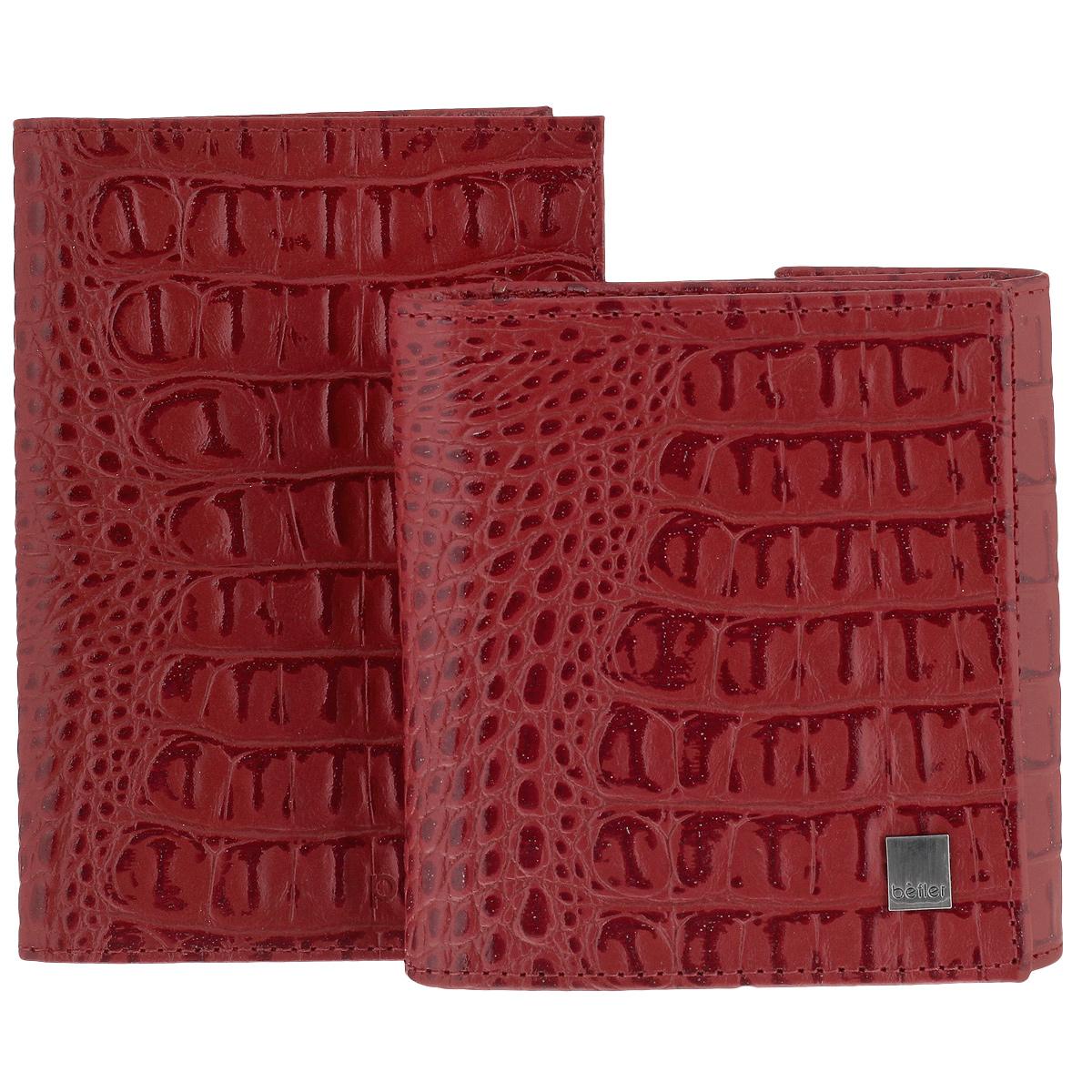 """Подарочный набор Befler Кайман: портмоне, обложка для паспорта, цвет: красный. O.1-13/PJ.120.-13O.1-13/PJ.120.-13 красныйПодарочный женский набор Кайман состоит из обложки для паспорта и портмоне. Предметы набора выполнены из натуральной кожи и оформлены декоративным тиснением """"под крокодила"""". Обложка для паспорта не только поможет сохранить внешний вид ваших документов и защитить их от повреждений, но и станет стильным аксессуаром, идеально подходящим вашему образу. На развороте два вертикальных кармана из прозрачного пластика. Полнокупюрное женское портмоне украшено фирменным металлическим логотипом. Портмоне закрывается широким клапаном на кнопку. Внутри -отделение для купюр и 6 карманов для кредитных карт. На внешней стороне расположен карман для мелочи на кнопке. Подарочный набор Кайман станет великолепным подарком для человека, ценящего качественные и практичные вещи."""