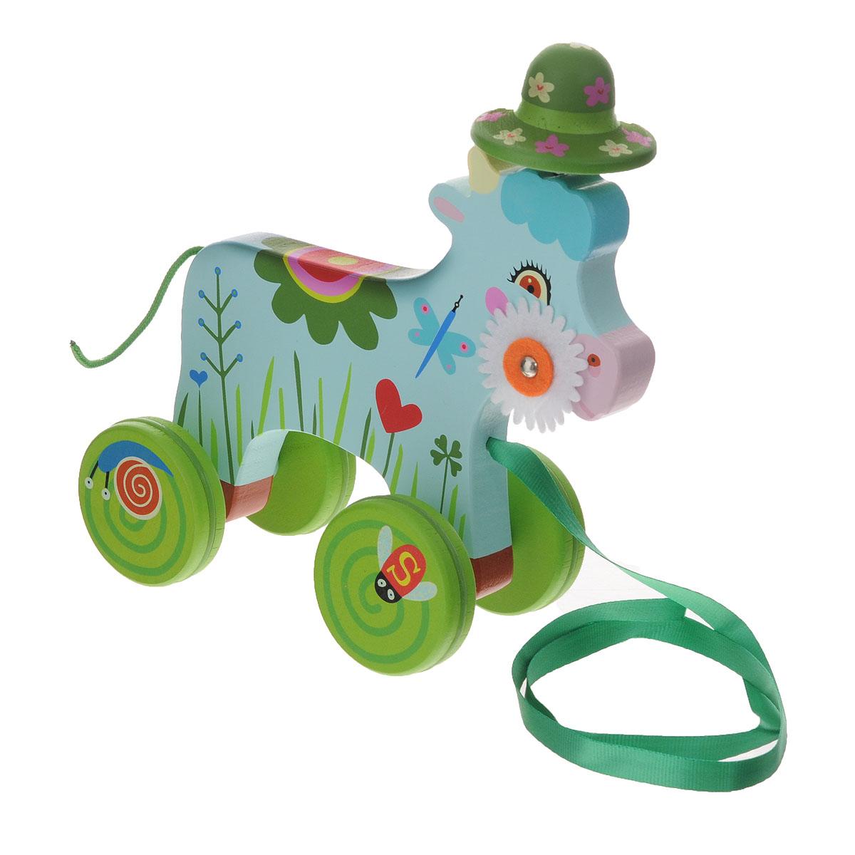 Djeco Деревянная игрушка-каталка Корова06229Деревянная игрушка-каталка Djeco Корова непременно понравится вашему малышу и подойдет для игры как дома, так и на свежем воздухе. Она выполнена из дерева с использованием нетоксичных красок в виде забавной коровки со шляпкой на металлической пружинке и текстильным хвостиком-шнурком. Края игрушки закруглены, чтобы избежать вероятности травмирования. Сбоку мордашки коровки расположен текстильный цветочек, который малыш сможет вращать. Каталка оснащена четырьмя колесиками, оформленными веселыми картинками. К коровке прикреплена лента, благодаря которой малыш сможет возить игрушку за собой. Игрушка-каталка Djeco Корова развивает пространственное мышление, цветовое восприятие, ловкость, равновесие и координацию движений. Контрастное оформление коровки стимулируют развитие координации глаз, учат следить за мелкими движущимися объектами.