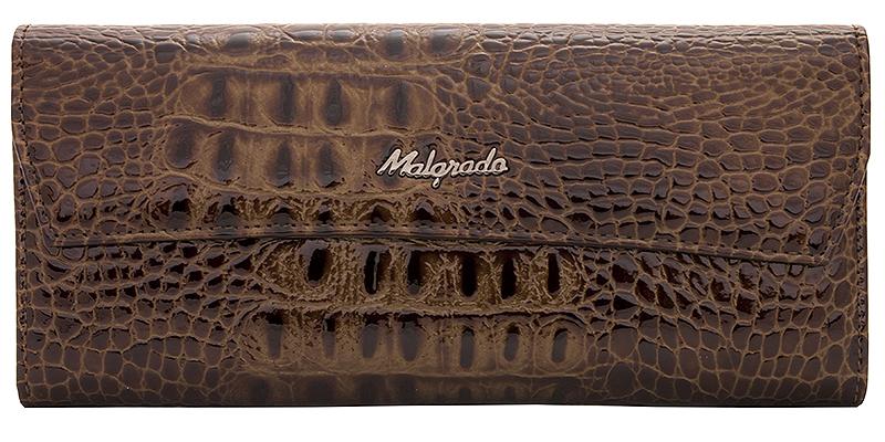 Кошелек женский Malgrado, цвет: кофе. 75504-6575504-65# CoffeeСтильный женский кошелек Malgrado выполнен из высококачественной натуральной кожи с декоративным тиснением под рептилию и оформлена металлической пластиной с надписью в виде названия бренда. Закрывается клапаном на застежку-кнопку. Внутри содержится два отделения для купюр, четыре кармана для бумаг (один из которых расположен под клапаном), карман для мелочи на застежке-молнии, девять отделений для визиток и пластиковых карт. С задней стороны - плоский карман для мелких бумаг. Кошелек упакован в подарочную металлическую коробку синего цвета с логотипом фирмы. Такой кошелек станет стильным аксессуаром, который идеально подойдет к вашему образу.