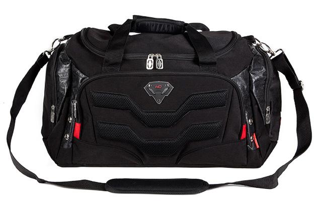 Сумка спортивная Hatber Protector, цвет: черныйNS_00013Сумка спортивная Hatber Protector - это стильная вместительная сумка, которая придется по вкусу любому. Сумка выполнена из плотного высококачественного твила. Внутри одно вметительное отделение, закрывающуюся на пластиковую застежку-молнию. В комплекте регулируемая съемная лямка через плечо. Вместительный карман на фронтальной стенке, закрывающийся на пластиковую застежку-молнию. Рюкзак снабжен двумя боковыми карманами. Длина регулируемого ремня: 91-131 см.
