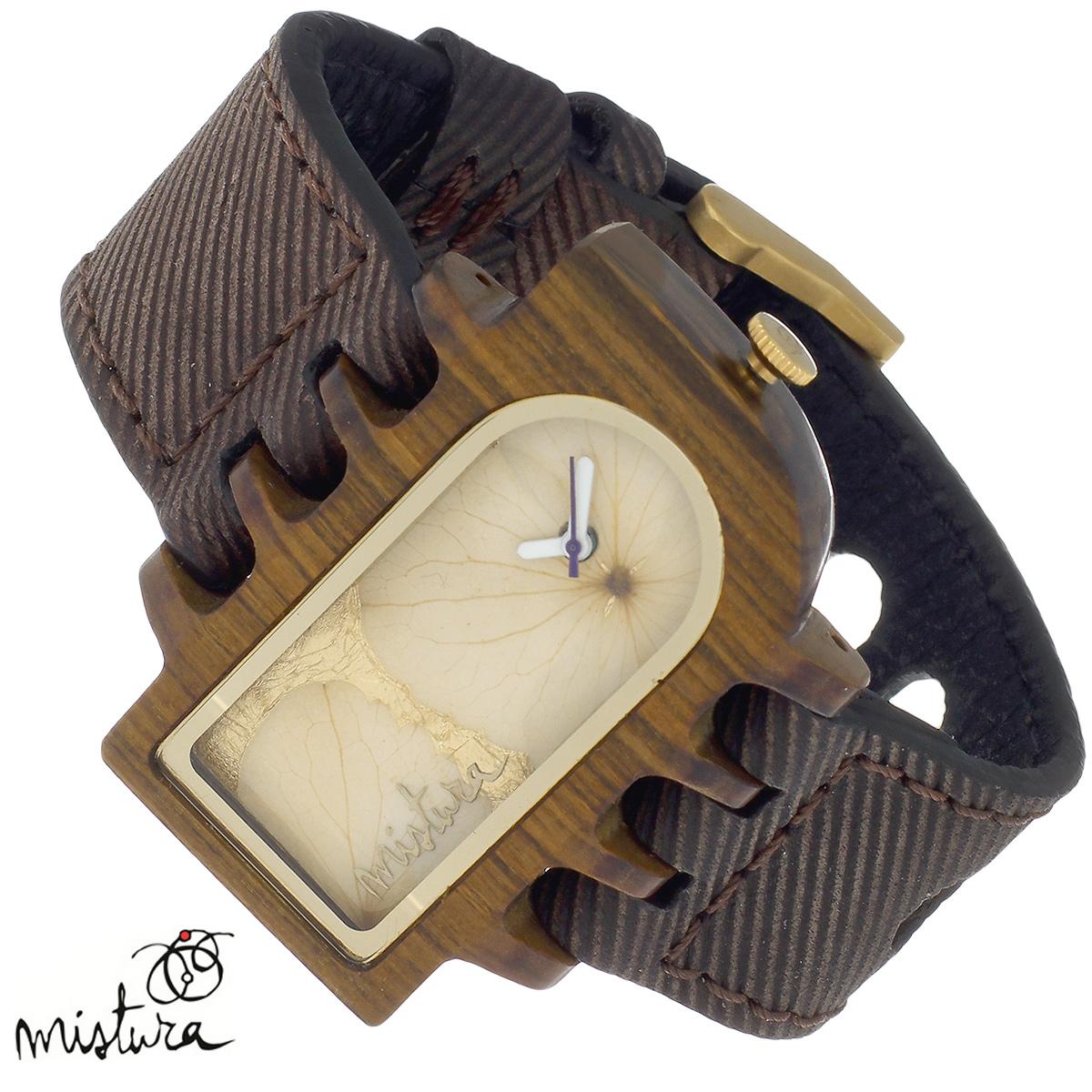 Часы наручные Mistura Umbra Se, цвет: коричневый. TP12016CJPUWFSETP12016CJPUWFSEНаручные часы Mistura благодаря своему эксклюзивному дизайну позволят вам выделиться из толпы и подчеркнуть свою индивидуальность. Для изготовления корпуса часов используется древесина тропических лесов Колумбии с применением индивидуальных методов ее обработки. Дизайн выполняется вручную. Часы оснащены японским кварцевым механизмом MIYOTA. Широкий ремешок из натуральной кожи с фактурной поверхностью оформлен декоративной отстрочкой, застегивается на застежку с деревянным язычком. Корпус часов изготовлен из дерева пуи. Циферблат оформлен лепестками и защищен минеральным стеклом. Часы имеют функцию защиты от брызг, вы можете находиться в них под дождем в течение недолгого времени. Изделие упаковано в фирменную коробку с логотипом компании Mistura. Часы марки Mistura идеально подходят молодым и уверенным в себе людям, ценящим качество, практичность и индивидуальность в каждой детали. Каждая модель оснащена оригинальным дизайнерским корпусом, а...