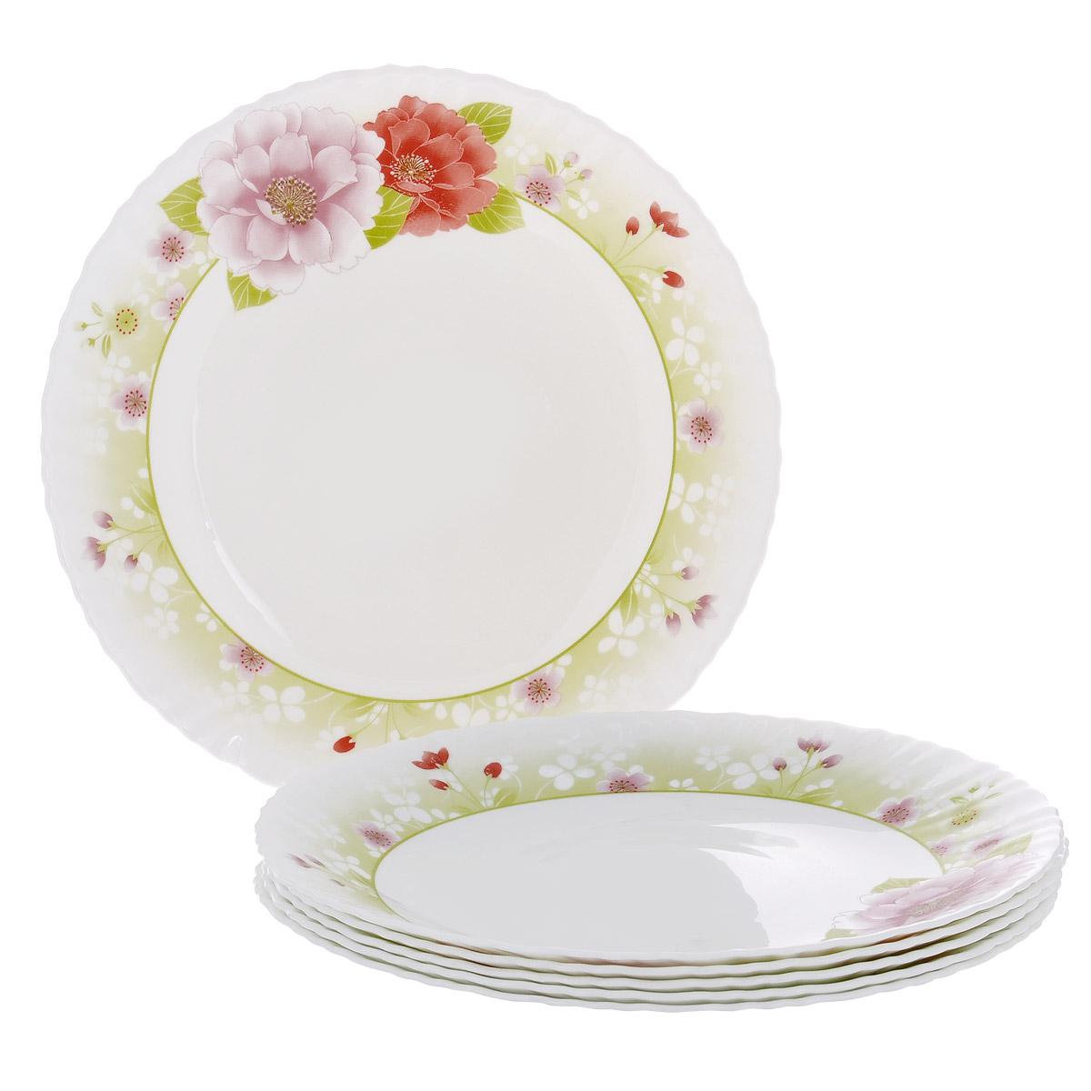 Набор тарелок Цветы, диаметр 26,5 см, 6 шт. Кт LHP105/6-1027LHP105/6-1027Набор тарелок Цветы, выполненный из высококачественного стекла, состоит из 6 мелких тарелок. Тарелки украшены принтом в виде цветов и фигурными краями. Они сочетают в себе изысканный дизайн с максимальной функциональностью. Оригинальность оформления тарелок придется по вкусу и ценителям классики, и тем, кто предпочитает утонченность и изящность. Набор тарелок Цветы послужит отличным подарком к любому празднику.