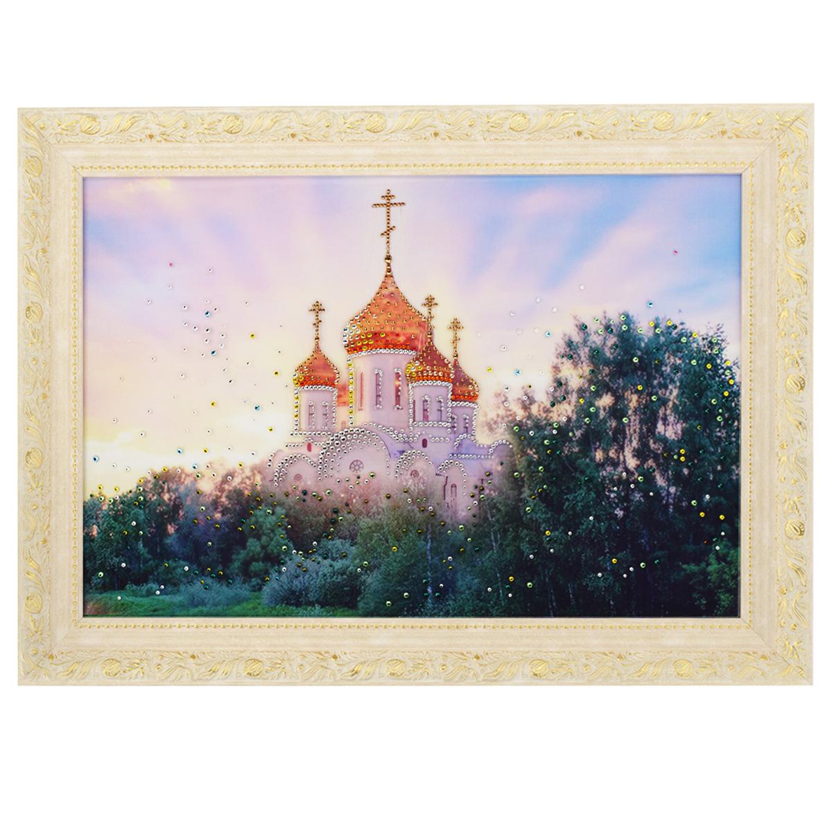 Картина с кристаллами Swarovski В лучах солнца, 70 см х 50 см1061Изящная картина в багетной раме, инкрустирована кристаллами Swarovski, которые отличаются четкой и ровной огранкой, ярким блеском и чистотой цвета. Красочное изображение церкви, расположенное под стеклом, прекрасно дополняет блеск кристаллов. С обратной стороны имеется металлическая проволока для размещения картины на стене. Картина с кристаллами Swarovski В лучах солнца элегантно украсит интерьер дома или офиса, а также станет прекрасным подарком, который обязательно понравится получателю. Блеск кристаллов в интерьере, что может быть сказочнее и удивительнее. Картина упакована в подарочную картонную коробку синего цвета и комплектуется сертификатом соответствия Swarovski.