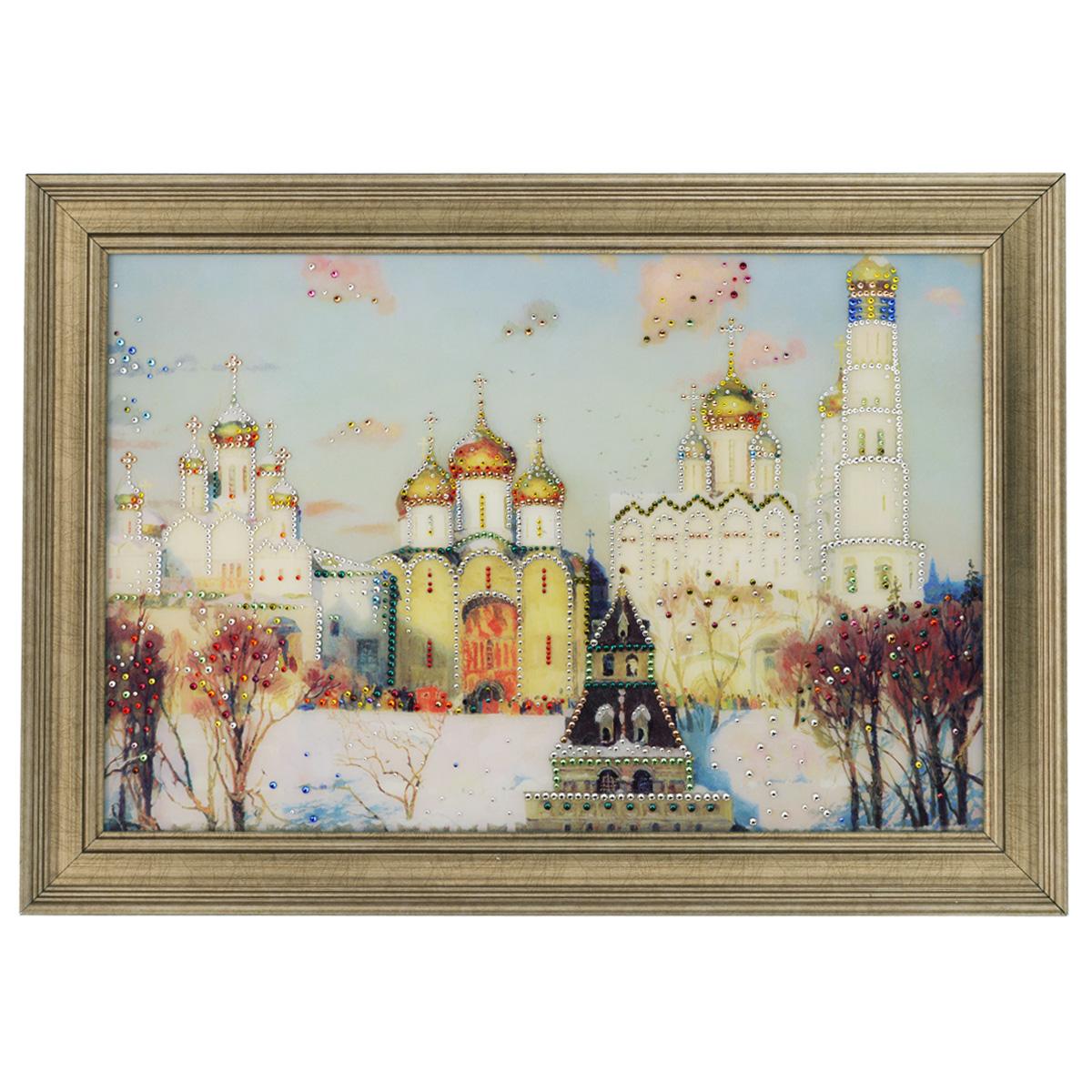 Картина с кристаллами Swarovski Золотые купола, 70 см х 50 см1154Изящная картина в багетной раме, инкрустирована кристаллами Swarovski, которые отличаются четкой и ровной огранкой, ярким блеском и чистотой цвета. Красочное изображение церквей, расположенное под стеклом, прекрасно дополняет блеск кристаллов. С обратной стороны имеется металлическая проволока для размещения картины на стене. Картина с кристаллами Swarovski Золотые купола элегантно украсит интерьер дома или офиса, а также станет прекрасным подарком, который обязательно понравится получателю. Блеск кристаллов в интерьере, что может быть сказочнее и удивительнее. Картина упакована в подарочную картонную коробку синего цвета и комплектуется сертификатом соответствия Swarovski.