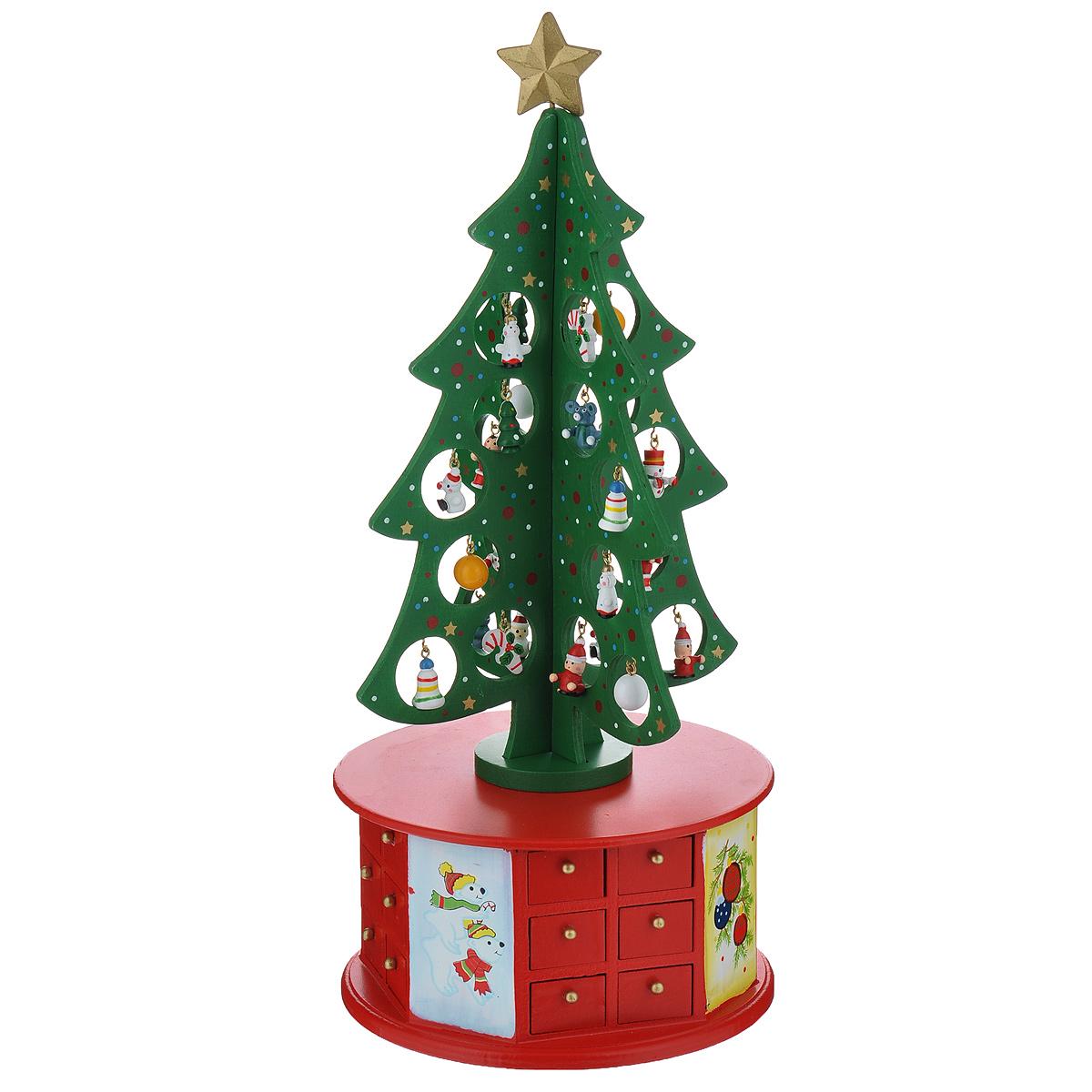 Новогоднее украшение Новогодняя елка, цвет: красный, зеленый. Ф21-2233Ф21-2233Новогоднее украшение, выполненное из дерева, отлично подойдет для декорации вашего дома. Украшение выполнено в виде круглой подставки-шкатулки с выдвигающимися миниатюрными ящичками, сверху которой установлена зеленая елка украшенная новогодними игрушками и верхушкой-звездой желтого цвета. Подставка-шкатулка оформлена рисунками белых медведей и новогодних шаров. Новогодние украшения всегда несут в себе волшебство и красоту праздника. Создайте в своем доме атмосферу тепла, веселья и радости, украшая его всей семьей.