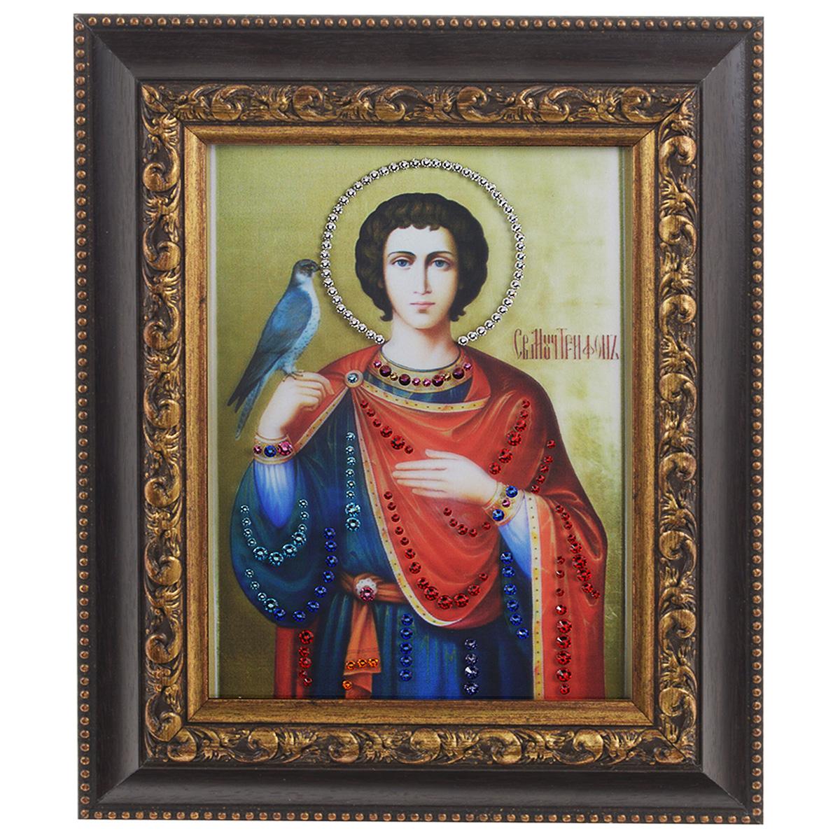 Картина с кристаллами Swarovski Икона. Святой Трифон, 22,5 см х 27,5 см1390Изящная картина в багетной раме, инкрустирована кристаллами Swarovski, которые отличаются четкой и ровной огранкой, ярким блеском и чистотой цвета. Красочное изображение иконы - Святой Трифон, расположенное на внутренней стороне стекла, прекрасно дополняет блеск кристаллов. С обратной стороны имеется металлическая проволока для размещения картины на стене. Картина с кристаллами Swarovski Икона. Святой Трифон элегантно украсит интерьер дома или офиса, а также станет прекрасным подарком, который обязательно понравится получателю. Блеск кристаллов в интерьере, что может быть сказочнее и удивительнее. Картина упакована в подарочную картонную коробку синего цвета и комплектуется сертификатом соответствия Swarovski.