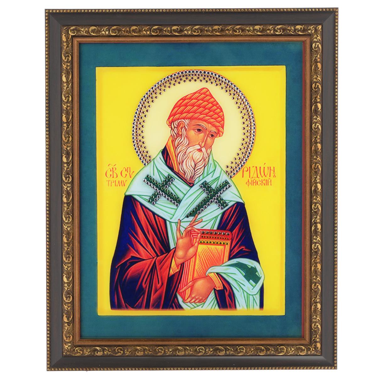 Картина с кристаллами Swarovski Икона. Святитель Спиридон Тримифудский, 37,5 см х 47,5 см1422Изящная картина в багетной раме, инкрустирована кристаллами Swarovski, которые отличаются четкой и ровной огранкой, ярким блеском и чистотой цвета. Красочное изображение Иконы Святитель Спиридон Тримифудский, расположенное под стеклом, прекрасно дополняет блеск кристаллов. С обратной стороны имеется металлическая проволока для размещения картины на стене. Картина с кристаллами Swarovski Икона. Святитель Спиридон Тримифудский элегантно украсит интерьер дома или офиса, а также станет прекрасным подарком, который обязательно понравится получателю. Блеск кристаллов в интерьере, что может быть сказочнее и удивительнее. Картина упакована в подарочную картонную коробку синего цвета и комплектуется сертификатом соответствия Swarovski.