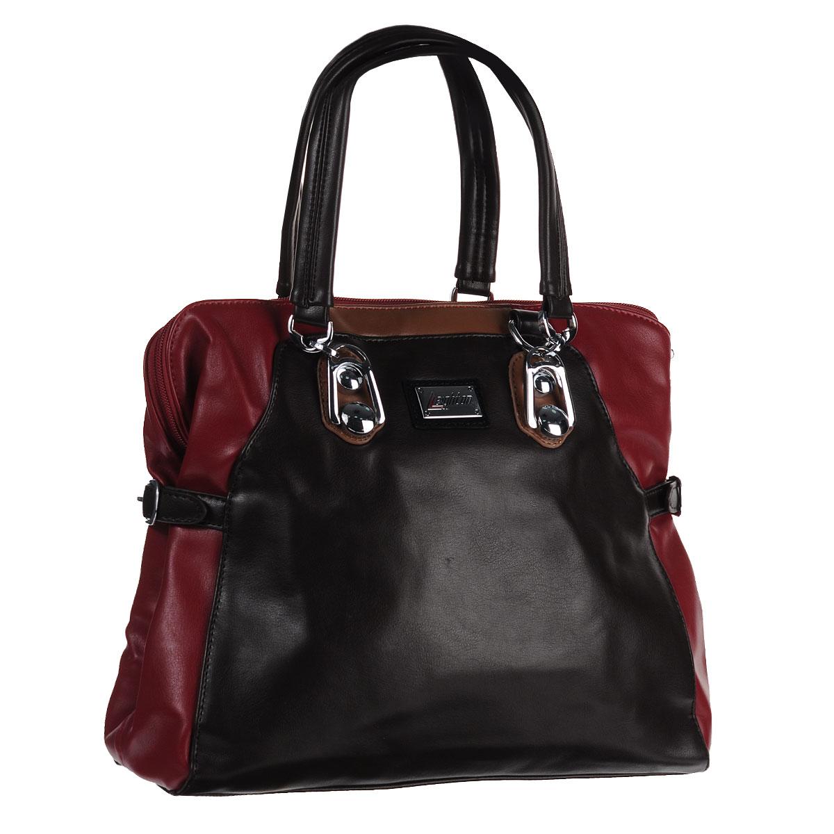 Сумка женская Leighton, цвет: коричневый, бордовый. 11090-201/1166/619/1166/20611090-201/1166/619/1166/2Стильная миниатюрная сумка Leighton выполнена из высококачественной искусственной кожи с отделкой контрастного цвета. По бокам сумка декорирована ремешками. Сумка имеет одно вместительное отделение, закрывающееся на застежку-молнию. Внутри - смежный карман на молнии, вшитый кармашек на молнии и два накладных кармана для мелочей. С внешней стороны на задней стенке сумки расположен вшитый карман на молнии. Сумка оснащена двумя ручками, позволяющими носить ее на плече. В комплекте чехол для хранения и съемный плечевой ремень. Фурнитура - серебристого цвета. Сумка - это стильный аксессуар, который подчеркнет вашу индивидуальность и сделает ваш образ завершенным. Классическое цветовое сочетание, стильный декор, модный дизайн - прекрасное дополнение к гардеробу модницы.