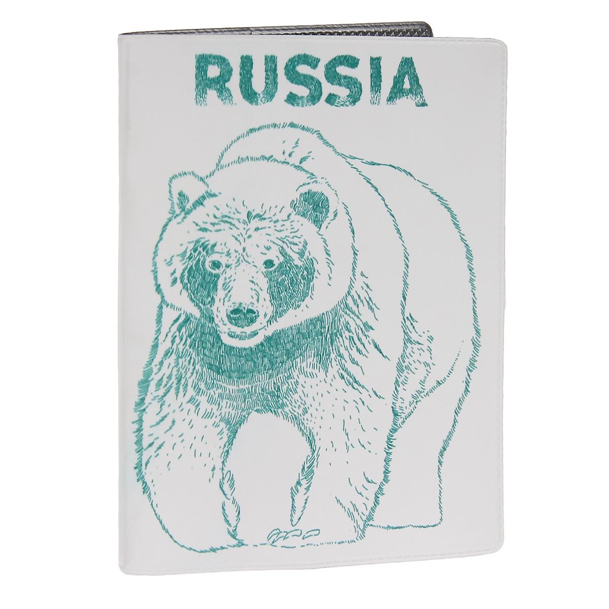 Обложка для автодокументов Медведь. AUTOZAM302AUTOZAM302Обложка для автодокументов Mitya Veselkov Медведь изготовлена из прочного ПВХ белого цвета и оформлена изображением в виде медведя и надписью Russia. На внутреннем развороте имеются съемный блок из шести прозрачных файлов из мягкого пластика для водительских документов, один из которых формата А5, а также два боковых кармашка для визиток или банковских карт. Стильная обложка не только поможет сохранить внешний вид ваших документов и защитит их от грязи и пыли, но и станет аксессуаром, который подчеркнет вашу яркую индивидуальность.