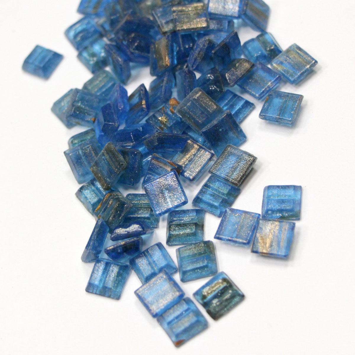 Мозаичная смальта Голубой топаз, 1 x 1 см, 100 гGA62Мозаичная смальта Голубой топаз - это оригинальный способ украсить открытку, фоторамку, подарочную коробку, фотоальбом и многое другое. Прекрасно подходит для скрапбукинга, декорирования и других видов творческих работ. Смальта выполнена из стекла голубого цвета. Крепится с помощью клея (в комплект не входит).