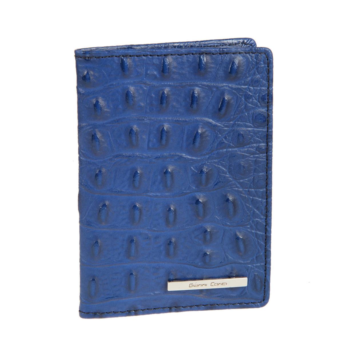 Обложка для паспорта Gianni Conti, цвет: синий. 19374551937455 blue/indigoСтильная обложка Gianni Conti выполнена из натуральной кожи с фактурным тиснением под крокодила и оформлена металлической пластинкой с надписью в виде логотипа бренда. На внутреннем развороте справа расположено шесть кармашков для пластиковых карт и визиток. Ширина левого разворота 3 см, правого 7 см. Оба разворота изготовлены из натуральной кожи. Такая обложка не только поможет сохранить внешний вид ваших документов и защитит их от повреждений, но и станет ярким аксессуаром, который подчеркнет ваш образ. Обложка упакована в подарочную картонную коробку желтого цвета с логотипом фирмы.