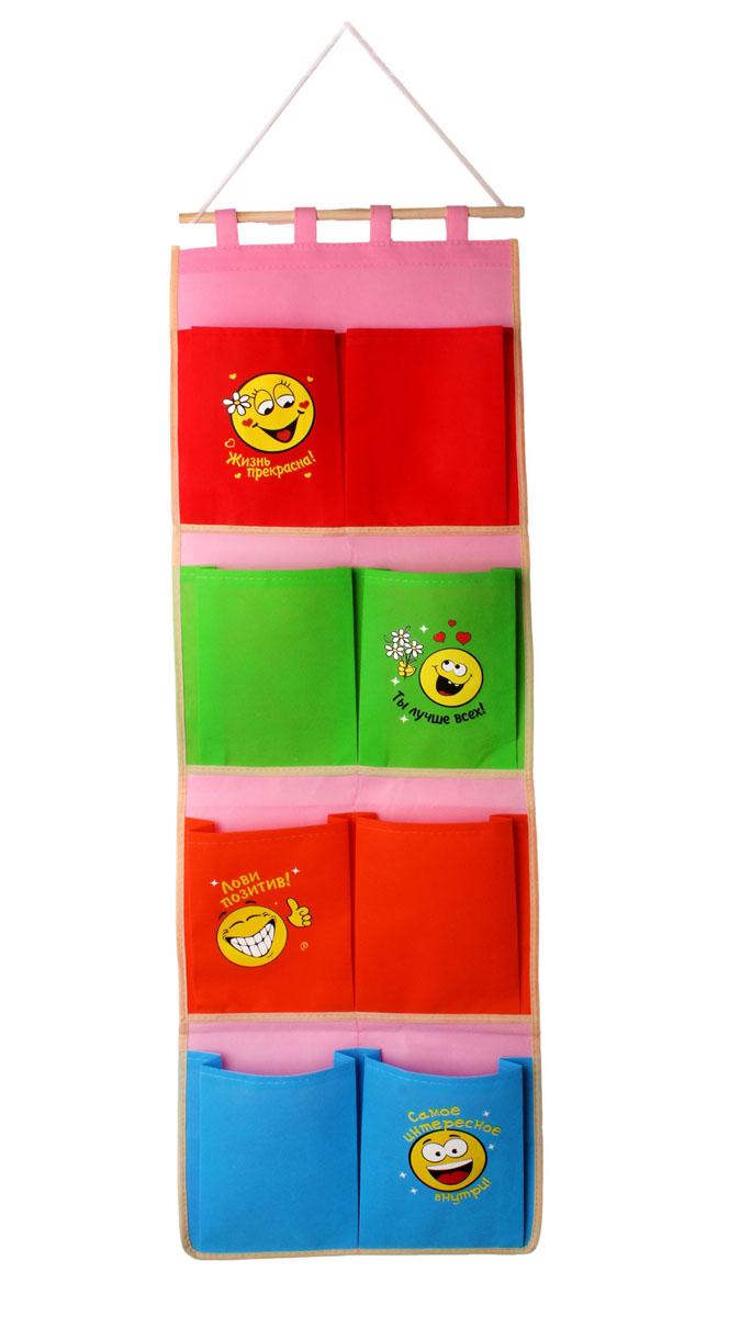 Кармашки на стену Sima-land Смайлики, 8 шт670608Кармашки на стену Sima-land Смайлики, изготовленные из текстиля, предназначены для хранения необходимых вещей, множества мелочей в гардеробной, ванной, детской комнатах. Изделие представляет собой текстильное полотно с 8 пришитыми кармашками. Благодаря деревянной планке и шнурку, кармашки можно подвесить на стену или дверь в необходимом для вас месте. Кармашки декорированы изображениями смайликов и надписями. Этот нужный предмет может стать одновременно и декоративным элементом комнаты. Яркий дизайн, как ничто иное, способен оживить интерьер вашего дома.