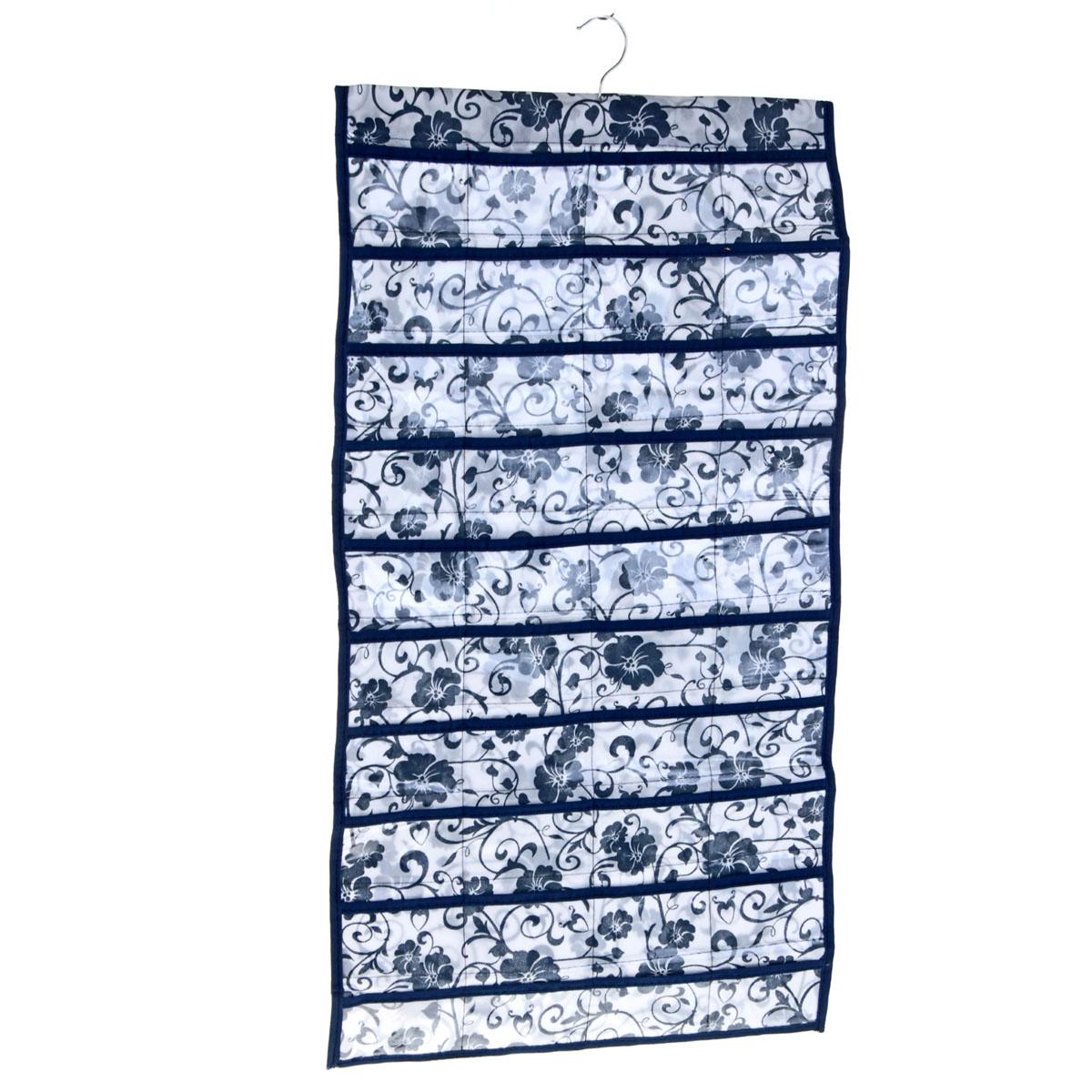 Органайзер для хранения вещей Sima-land с вешалкой, цвет: синий, 80 отделений709828Органайзер Sima-land, изготовленный из ПВХ и текстиля, предназначен для хранения необходимых вещей, множества мелочей в гардеробной, ванной, детской комнатах. Изделие представляет собой текстильное полотно с 80 пришитыми кармашками. Благодаря металлической вешалке, органайзер можно подвесить на стену или дверь в необходимом для вас месте. Органайзер декорирован цветочным принтом. Этот нужный предмет может стать одновременно и декоративным элементом комнаты. Яркий дизайн, как ничто иное, способен оживить интерьер вашего дома.