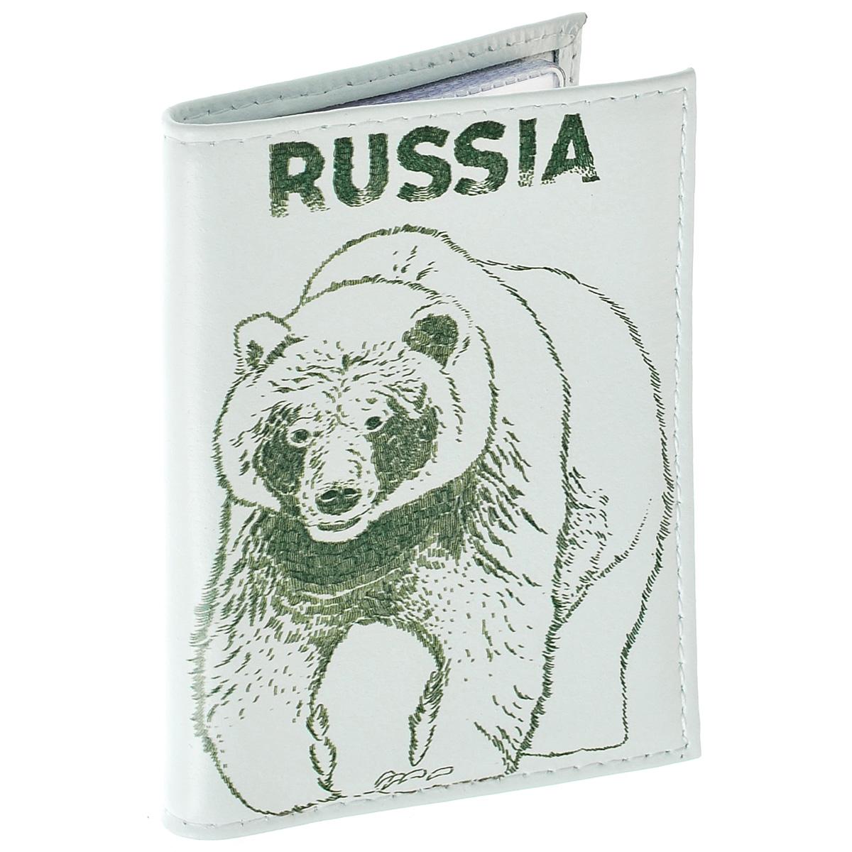 Визитница Медведь. VIZIT-225VIZIT-225Оригинальная визитница Mitya Veselkov Медведь прекрасно подойдет для хранения визиток и кредитных карт. Обложка выполнена из натуральной высококачественной кожи и оформлена изображением медведя и надписью Russia. Внутри содержится съемный блок из прозрачного мягкого пластика на 18 визиток и 2 прозрачных вертикальных кармана. Стильная визитница подчеркнет вашу индивидуальность и изысканный вкус, а также станет замечательным подарком человеку, ценящему качественные и практичные вещи.