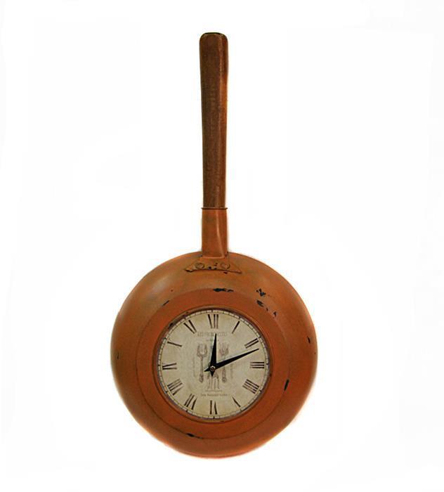 Часы настенные Сковорода. Металл, кварцевый часовой механизм. Конец XX векаST-903Часы настенные Сковорода. Металл, кварцевый часовой механизм. Западная Европа, конец XX века. Длина 65 см, диаметр 30 см, глубина 10 см. Сохранность хорошая. Оригинальные настенные часа, корпусом которым служит настоящая сковорода, станут оригинальным дополнением к вашему интерьеру! Отличный подарок любителю старины.
