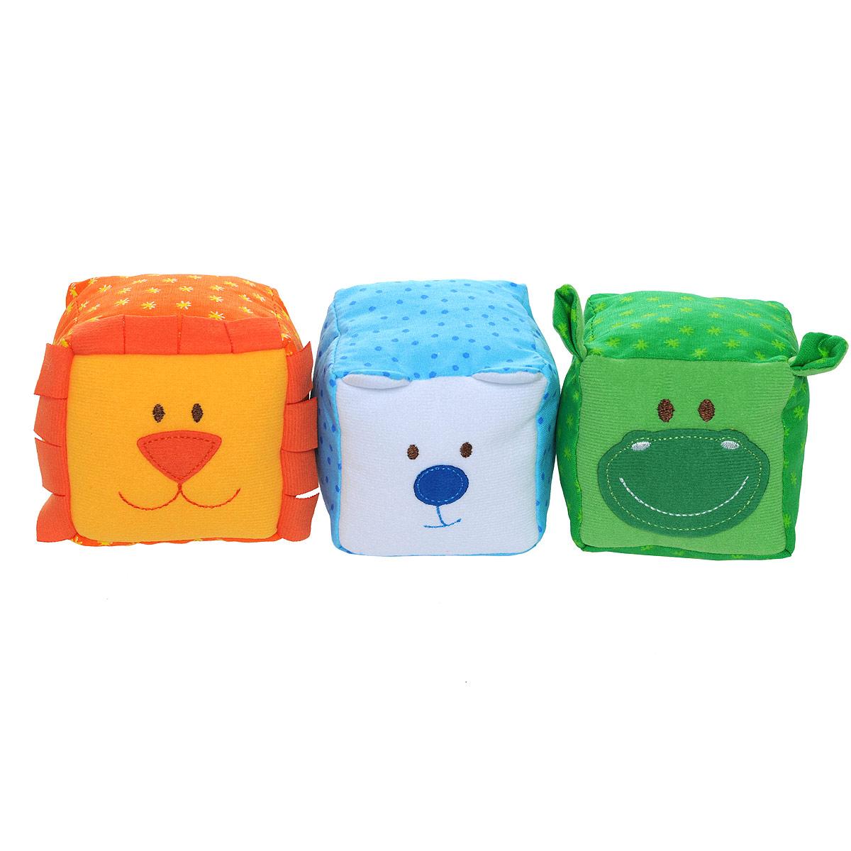 Мягкие кубики ЗооМякиши: Животные, 3 шт. 246246_лев,медведь,бегемотМягкие кубики ЗооМякиши: Животные помогут вашему ребенку увлекательно и с пользой провести время. Набор состоит из трех разноцветных кубиков, выполненных в виде животных: мишки, льва и бегемота. С помощью кубиков ваш ребенок познакомится с животными и сможет научиться первым навыкам конструирования. Кубики порадуют ребенка яркими цветами, милыми мордочками, поразительным сходством с птичками, а также разнообразием фактур. Внутри мишки спрятана погремушка, внутри льва - мелодичный колокольчик, а внутри бегемотика находится веселая пищалка. Кубики выполнены из высококачественной ткани с мягким наполнителем. Удачно подобранный размер, цвет и понятные рисунки помогут вашему малышу развить мышление, координацию движений и мелкую моторику рук, а также в игровой форме познакомиться с окружающим миром.