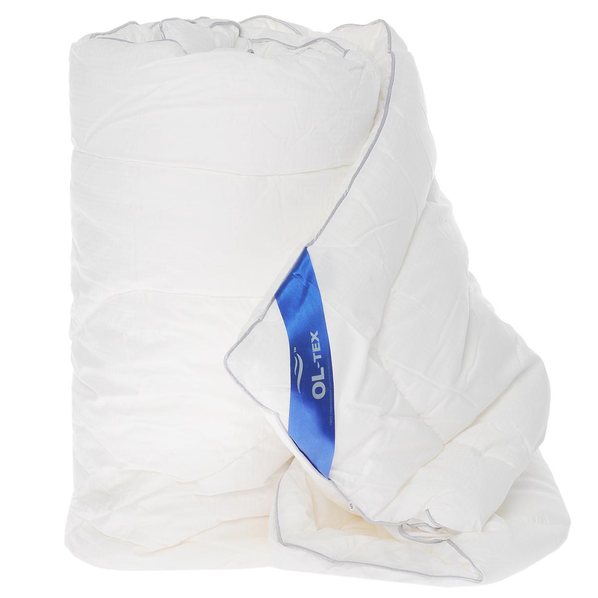 Одеяло теплое OL-Tex Nano Silver, наполнитель: микроволокно OL-Tex с ионами серебра, цвет: белый, 140 х 205 смОЛСС-15-4Красивое и теплое одеяло OL-Tex Nano Silver порадует Вас не только прекрасным внешним видом, но и полезными свойствами. Оно подарит вам ни с чем несравнимую мягкость и комфорт. Чехол одеяла белого цвета выполнен из сатина с жаккардовым узором, оформлен фигурной стежкой и атласным кантом по краю. Внутри - наполнитель из микроволокна OL-Tex с ионами серебра. Микроволокна наполнителя обогащены ионами серебра, известного своими антибактериальными, противовирусными и иммунозащитными свойствами. Изделия этой коллекции являются гипоаллергенными и способствуют снятию статического электричества. За одеялом легко ухаживать, оно не теряет своих свойств после многократных стирок. Основные свойства микроволокна OL-Tex с ионами серебра: - антибактериальный эффект, - антистатический эффект, - превосходная терморегуляция. Подарите себе здоровый сон! Нежное, легкое, теплое одеяло - прекрасный подарок себе и своим близким. Изделия OL-Tex -...