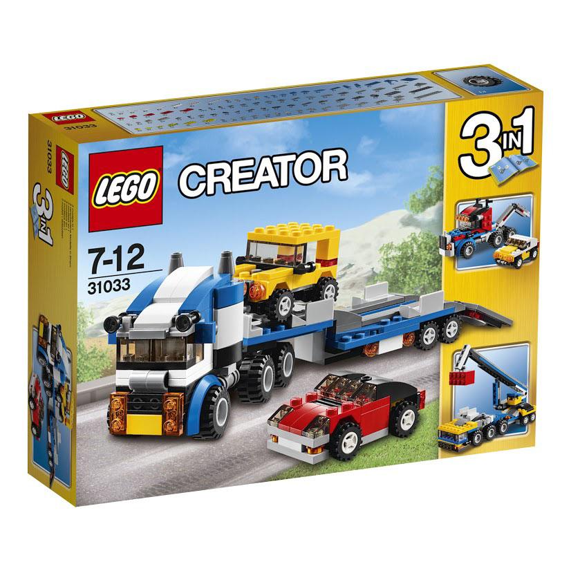 LEGO Creator Конструктор Автотранспортер 3103331033Заберитесь в кабину потрясающего перевозчика автомобилей! Откиньте аппарели и закатите автомобили на огромный шарнирно-соединенный с тягачом прицеп. Запустите двигатель и берите курс на автомагистраль! Транспортер для автомобилей из набора Лего 31033 представляет собой мощный тягач. Его кабина выполнена из бело-синих деталей. Спереди видны двойные фары, прямоугольная решётка радиатора, тонированное лобовое стекло и боковые зеркала. За откидной кабиной располагаются выхлопные трубы и сигнальные огни. При помощи специального крепления тягач соединяется с длинной транспортировочной платформой. Она базируется на четырех маленьких колесах и имеет специальные заградительные отбойники, позволяющие надёжно зафиксировать перевозимые автомобили. Также сзади платформы есть две прямоугольные направляющие, которые, опускаясь, образуют пандус. На автотранспортере вы сможете перевезти желтый внедорожник и красный спортивный автомобиль. При желании из деталей набора можно собрать две...