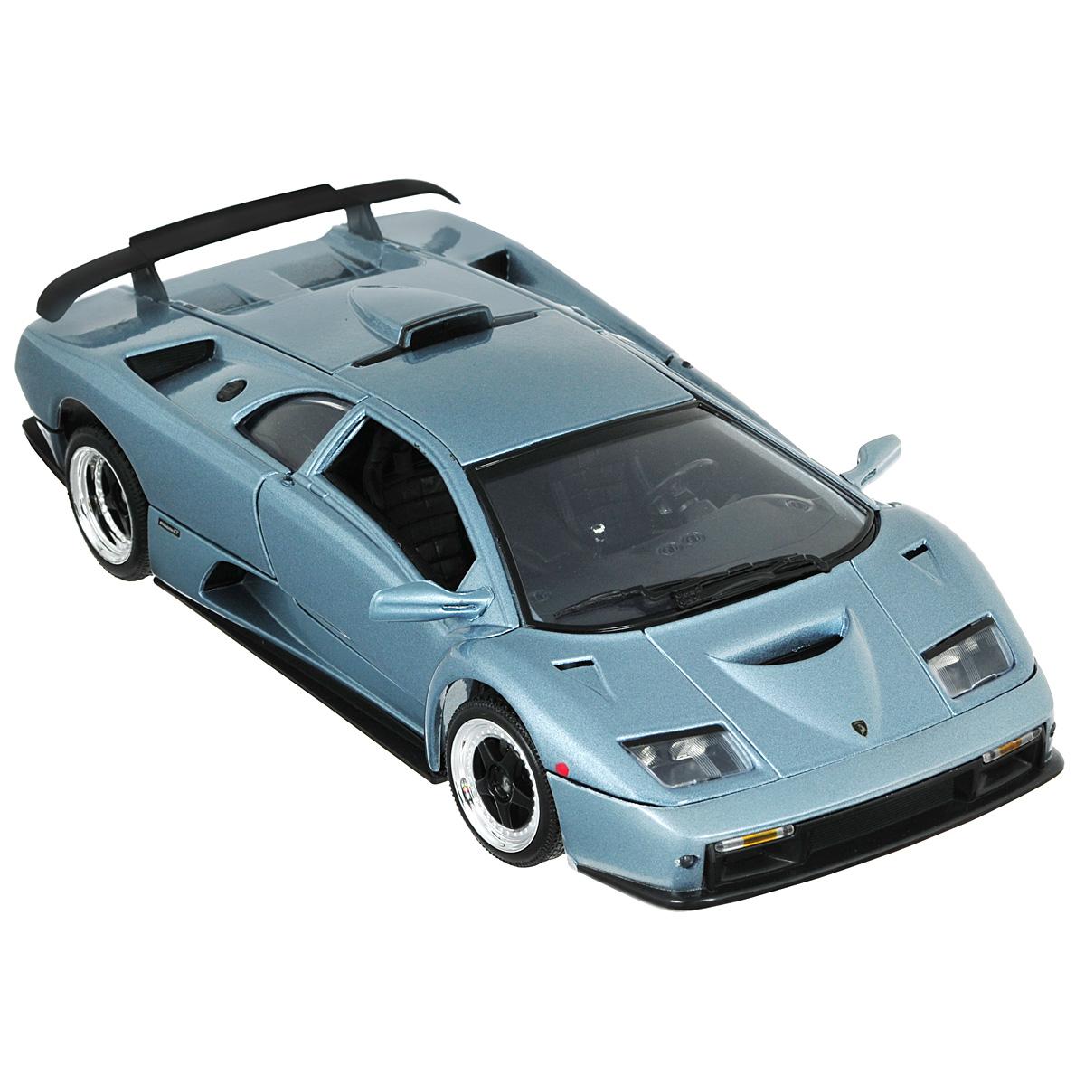 MotorMax Модель автомобиля Lamborghini Diablo GT цвет серыйgrey_metallic/ast73168Коллекционная модель MotorMax Lamborghini Diablo GT станет хорошим подарком для любого ценителя автомобилей. В мире существует всего 80 экземпляров этого итальянского суперкара, впервые увидевшего свет в 1999 году и до сих пор приковывающего к себе внимание. Вступите в элитный клуб владельцев Lamborghini Diablo GT, украсив свою коллекцию великолепной моделью в масштабе 1:18 от MotorMax. Модель максимально точно соответствует своему прототипу: открываются двери крыло бабочки и багажник. Машинка изготовлена из литого металла (Die Cast), для декорирования использованы пластиковые элементы. Колеса, поворачивающиеся при кручении руля, обуты в резиновые шины. Модель помещена на пластиковую подставку с оригинальным названием машины. Эта игрушка станет великолепным подарком для коллекционера. Она упакована в премиальную упаковку, что делает внешний вид машинки презентабельным.