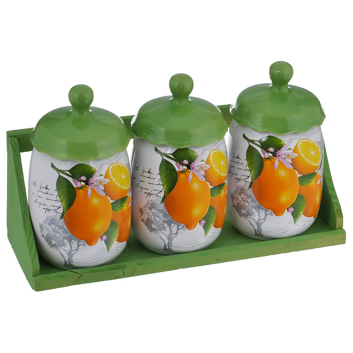 Набор банок для хранения сыпучих продуктов Лимоны, цвет: зеленый, белый, 4 предметаDFC00119-02207 3/SНабор Лимоны состоит из трех больших банок и подставки. Предметы набора изготовлены из доломитовой керамики и декорированы изображением лимонов. Изделия помещаются на удобную деревянную подставку. Оригинальный дизайн, эстетичность и функциональность набора позволят ему стать достойным дополнением к кухонному инвентарю. Можно мыть в посудомоечной машине на минимальной температуре. Диаметр основания: 7,5 см. Высота емкости (без учета крышки): 13 см. Размер подставки: 31,5 см х 11 см х 10,5 см.