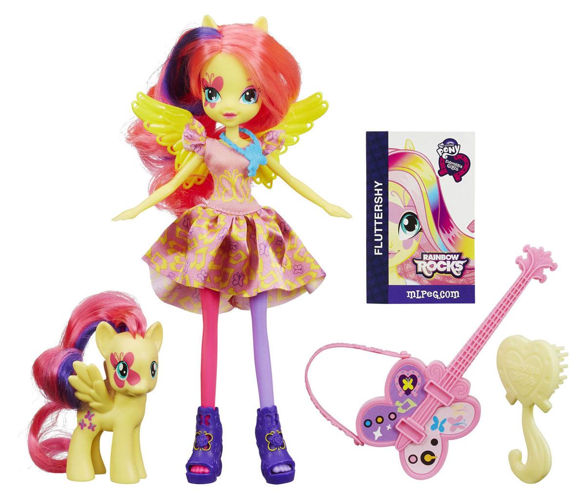 My Little Pony Игровой набор с куклой Флаттершай и пониA3996_A9886Куклы пони-девочки из мультфильма Equestria Girl (Девочки из Эквестрии) - это удивительные и очаровательные куклы, которых так давно ждали ценители маленьких пони. Кукла My Little Pony Equestria Girls: Fluttershy стильно одета и выглядит так, словно только что появилась прямиком из мультфильма. Кукла с длинными ярко-розовыми волосами с фиолетовой прядкой выполнена в виде девочки-пони Флаттершай. Ее эффектный образ создан специально для выступления на рок-концерте. Голова, руки и ноги Флаттершай подвижны, благодаря чему ей можно придавать различные позы. В комплект входят фигурка пони в виде Флаттершай с длинными гривой и хвостом, гитара на ремешке и расческа. Ваша малышка с удовольствием будет играть с этой куклой, каждый раз придумывая новые истории, а аксессуары сделают игру еще интереснее. Порадуйте ее таким замечательным подарком!
