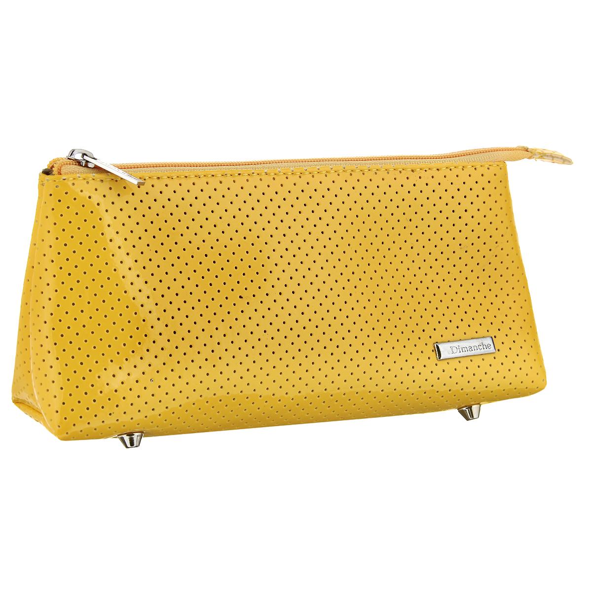 Косметичка Dimanche, цвет: желтый. 275275Косметичка Dimanche изготовлена из искусственной лакированной кожи с перфорацией. Косметичка имеет одно больше отделение и закрывается на застежку-молнию. Внутренняя поверхность отделана текстильной подкладкой. Дно оснащено четырьмя металлическими ножками, обеспечивающими необходимую устойчивость. Женская косметичка Dimanche - это стильный и полезный аксессуар для любой современной модницы. В косметичке поместится вся необходимая косметика, а благодаря компактным размерам ее всегда можно носить с собой в сумочке.