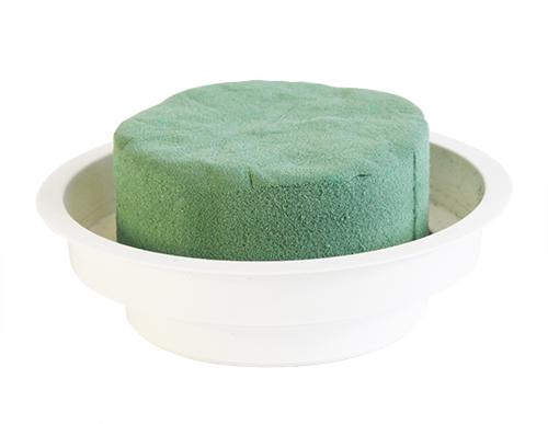 Пена флористическая для живых цветов Hobby Time, в чаше, цвет: зеленый, 8 см х 8 см х 5 см7705245Флористическая пена Hobby Time, изготовленная из сложных полимеров, это широчайшие возможности для вашего творчества. Выбирая этот материал в качестве основы для цветочной композиции, вы выбираете лучшее! Флористическая губка насыщается водой в считанные секунды и удерживает объем жидкости, в 40 раз превышающий собственный вес. Пена легко режется ножом, ей можно придать любую форму. Пена зеленого цвета используется для живых свежесрезанных растений, пена коричневого и серого цветов - для композиций из сухоцветов, искусственных и бумажных цветов, для конфетной флористики и бисероплетения, в качестве удобной базы для композиции. Пена, выполненная в форме цилиндра, помещена в пластиковую чашу.