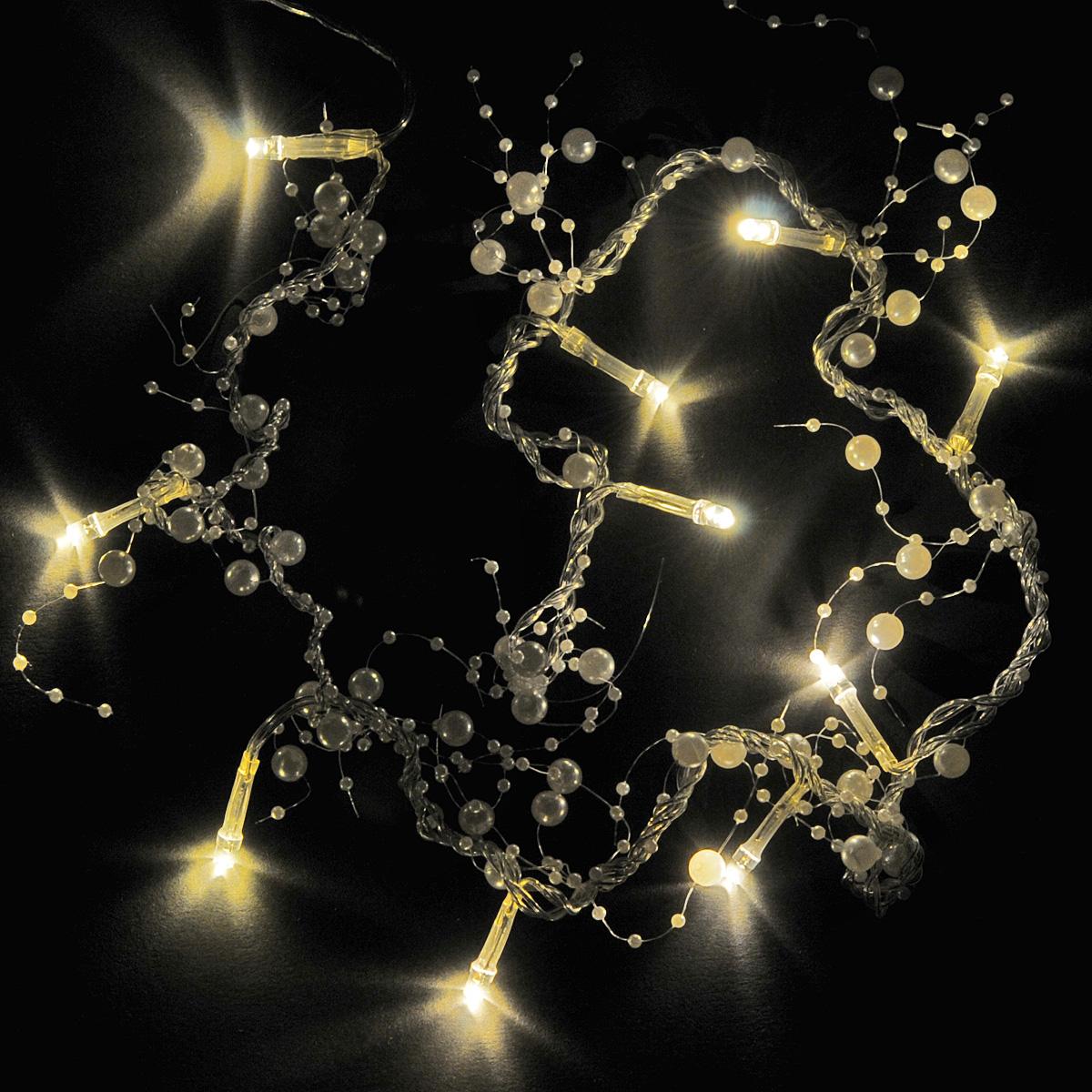 Гирлянда электрическая Lunten Ranta Жемчуг, цвет: белый, 10 светодиодов, 2 м67628Гирлянда электрическая Lunten Ranta Жемчуг выполнена из акрила. Гирлянда выполнена в оригинальном стиле и декорирована жемчугом. Такая гирлянда украсит ваш дом изнутри. Оригинальный дизайн и красочное исполнение создадут праздничное настроение. Откройте для себя удивительный мир сказок и грез. Почувствуйте волшебные минуты ожидания праздника, создайте новогоднее настроение вашим дорогим и близким. Работает от 2-х батареек тапа АА напряжением 1.5 V (в комплект не входит).