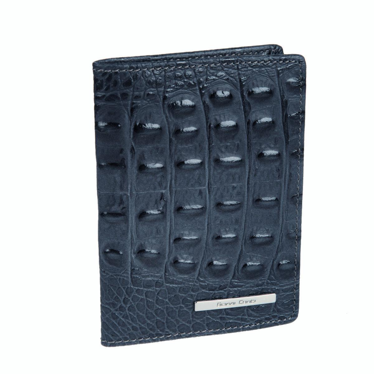 Обложка для паспорта Gianni Conti, цвет: сине-серый. 19374551937455 grey/yellowСтильная обложка Gianni Conti выполнена из натуральной кожи с фактурным тиснением под крокодила и оформлена металлической пластинкой с надписью в виде логотипа бренда. На внутреннем развороте справа расположено шесть кармашков для пластиковых карт и визиток. Ширина левого разворота 3 см, правого 7 см. Оба разворота изготовлены из натуральной кожи. Такая обложка не только поможет сохранить внешний вид ваших документов и защитит их от повреждений, но и станет ярким аксессуаром, который подчеркнет ваш образ. Обложка упакована в подарочную картонную коробку желтого цвета с логотипом фирмы.