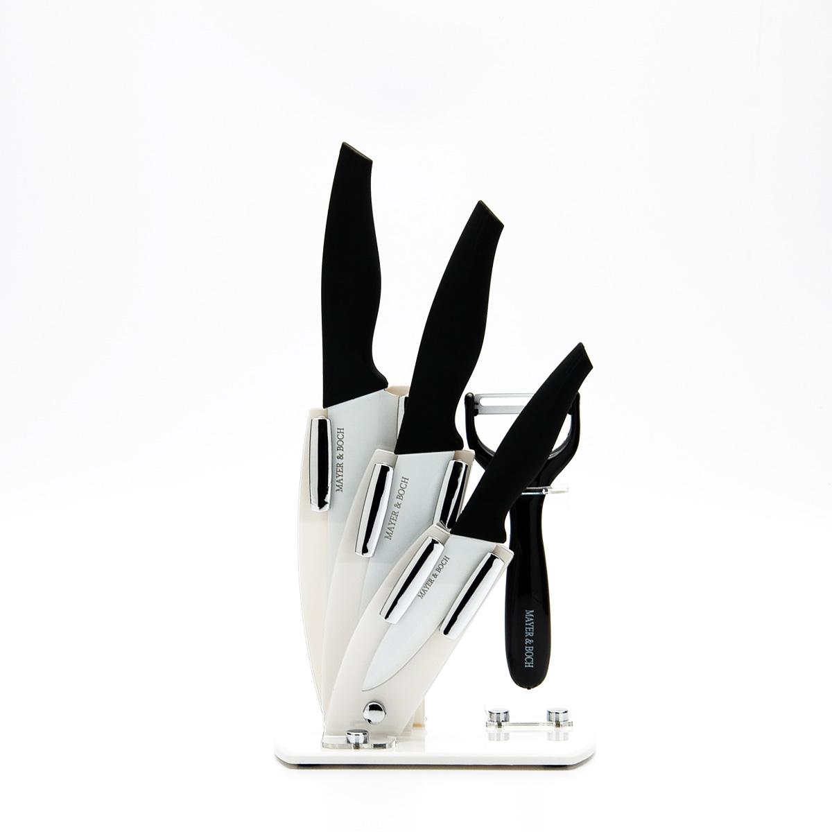 Набор ножей Mayer & Boch, 5 предметов. 2332123321Набор кухонных ножей Mayer & Boch состоит из поварского ножа, двух универсальных ножей, ножа-пиллера и подставки. Ножи выполнены из нержавеющей стали, ручки из полипропилена и каучука. Ножи помещаются на акриловой подставке. Оригинальный набор ножей великолепно украсит интерьер кухни и станет замечательным помощником. Можно мыть в посудомоечной машине. Длина лезвия поварского ножа: 15,2 см. Общая длина поварского ножа: 27 см. Длина лезвия универсального ножа: 12,7 см. Общая длина универсального ножа: 25 см. Длина лезвия универсального ножа: 10,2 см. Общая длина универсального ножа: 21,5 см. Длина лезвия ножа-пиллера: 4 см. Общая длина ножа-пиллера: 16 см. Размер подставки (ДхШхВ): 16,5 см х 9,5 см х 19 см.
