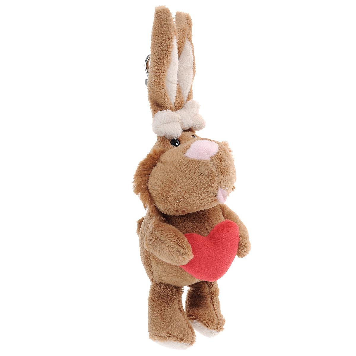 Брелок Gulliver Кролик с сердцем, цвет: коричневый, 19 см7-54711Очаровательный брелок Gulliver Кролик с сердцем вызовет улыбку как у взрослого, так и у ребенка. Он выполнен из полиакрила и модакрила с набивкой из синтепона в виде милого кролика. Глазки игрушки пластиковые; в лапках кролик держит сердечко. К игрушке крепится карабин, с помощью которого ее можно пристегнуть к сумке, рюкзачку или связке ключей. Оригинальный стиль и великолепное качество исполнения делают этот брелок чудесным подарком к любому празднику, а трогательный образ представит такой подарок в самом лучшем свете.