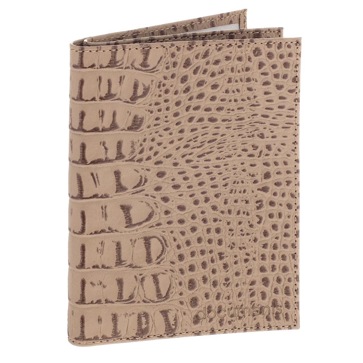 Бумажник водителя Befler, цвет: бежевый. BV.22.-13BV.22.-13. бежевыйУльтрамодный бумажник водителя Befler изготовлен из натуральной кожи и декорирован тиснением под рептилию. Изделие с обеих сторон дополнено тиснеными надписями. В бумажнике два отделения. Первое предназначено для автодокументов, содержит съемный блок из 6 прозрачных файлов и два боковых кармана (один - с окошком из пластика). Второе - для паспорта, содержит два боковых прозрачных кармана, которые обеспечат надежную фиксацию вашего документа. Изделие упаковано в фирменную коробку. Такой бумажник не только защитит ваши документы, но и станет стильным аксессуаром, который прекрасно дополнит образ.