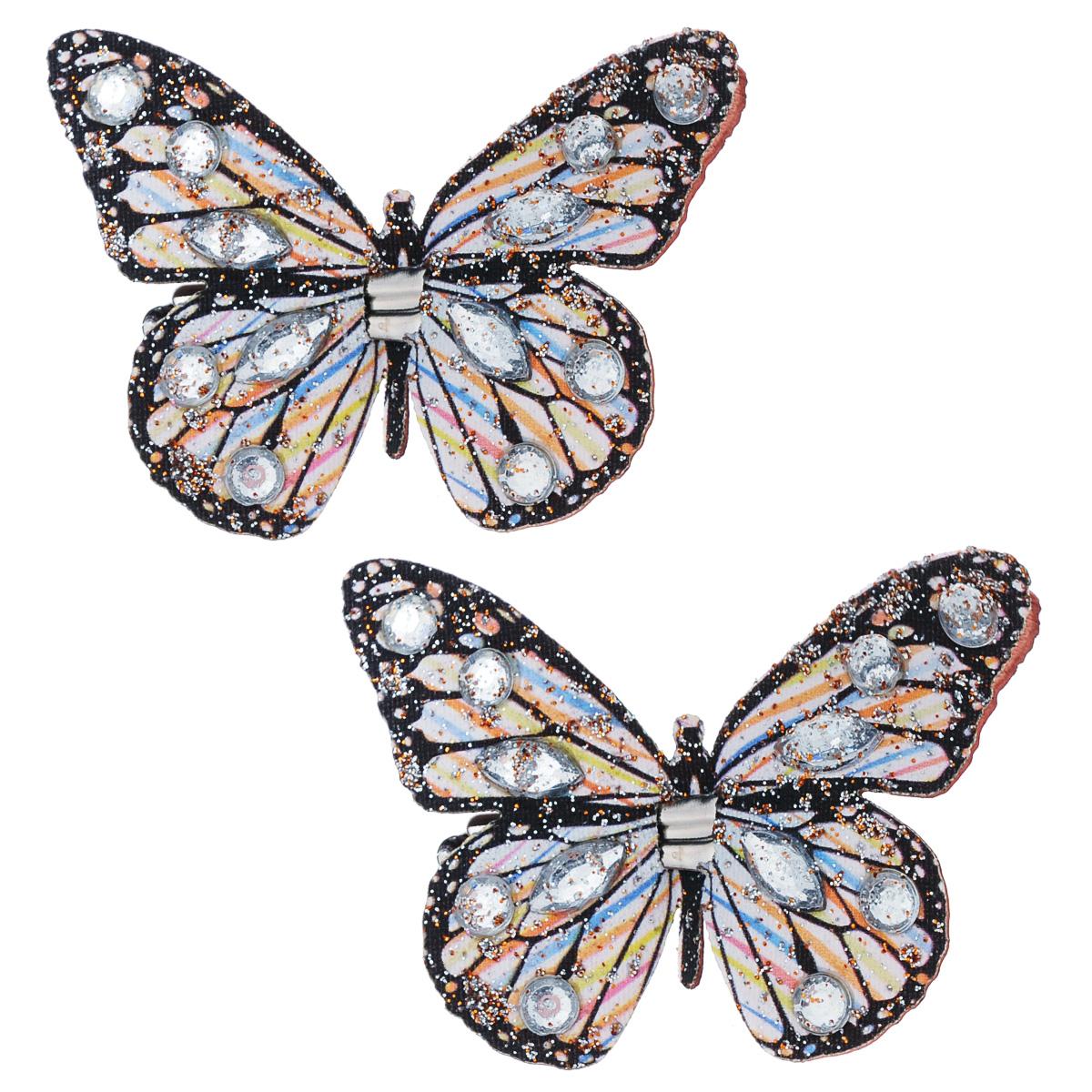 Набор декоративных элементов Hobby Time Бабочки, 5 х 4 см, 2 шт. 77054967705496Набор декоративных элементов Hobby Time Бабочки, изготовленный из текстиля, предназначен для декорирования. Он может пригодиться в оформлении одежды, предметов интерьера, подарков, цветочных букетов, а также в скрапбукинге. В наборе - 2 элемента. Изделия выполнены в виде бабочек, декорированных оригинальным узором и стразами. С оборотной стороны бабочки оснащены металлическими клипсами.