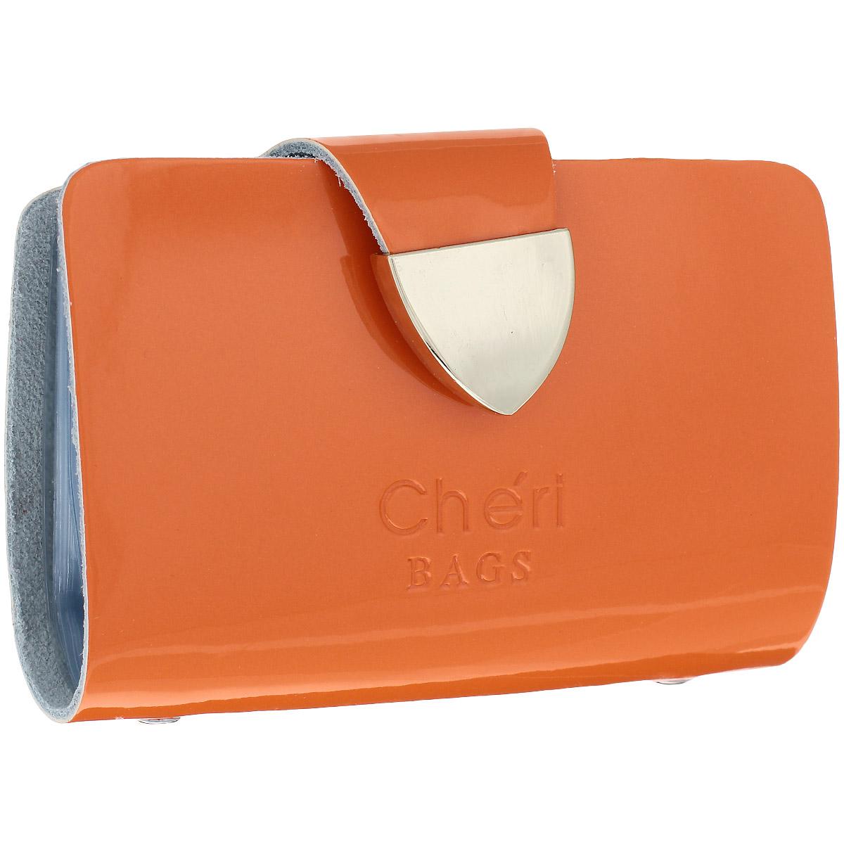 Визитница Cheribags, цвет: оранжевый. V-0482-22V-0482-22Изысканная визитница Cheribags изготовлена из натуральной лаковой кожи и декорирована тисненым названием бренда спереди. Изделие закрывается хлястиком, оформленным металлической пластиной, на кнопку. Внутри - блок из прозрачного мягкого пластика на 26 визиток, который крепится к корпусу визитницы на металлические заклепки. Стильная визитница - это не только практичная вещь для хранения пластиковых карт, но и модный аксессуар, который подчеркнет ваш неповторимый стиль.