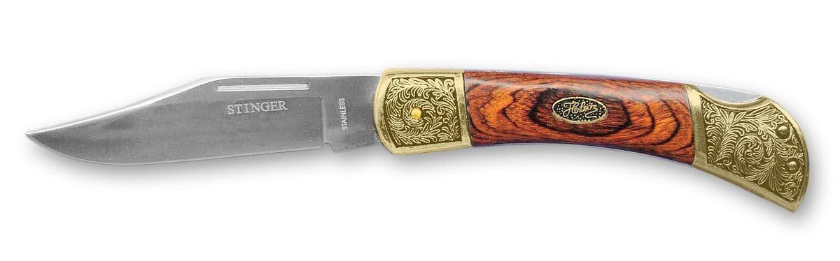 Нож складной Stinger YD-9703LW, цвет: золотистый, 10 см6909999306831Нож Stinger YD-9703LW всегда найдет себе применение на даче или в гараже, на рыбалке или охоте. Малые габариты делают его удобным при частой транспортировке. Лезвие выполнено из высококачественной нержавеющей стали. В открытом состоянии нож фиксируется, что значительно повышает безопасность. Он упакован в подарочную деревянную коробку.
