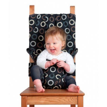 Дорожный детский стульчик Totseat, цвет: кофейный1000100004Дорожный детский стульчик Totseat - незаменимая вещь в дороге или в гостях, если вы решили покормить малыша, а под рукой нет детского стульчика. Его очень легко использовать - накиньте на стул, отрегулируйте длину и защелкните. Это компактный стульчик для кормления, предназначенный для детей от 6 до 30 месяцев, подходит для любого обычного стула со спинкой и легко поместиться в женскую сумочку. Totseat - это отличный подарок и полезный аксессуар в поездке. Вы можете взять его на пикник и посадить кроху отдыхать в шезлонге. А дополнительная упаковочная сумочка на молнии отлично подойдет для мокрого слюнявчика!